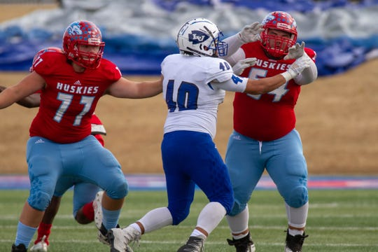 Hirschi's Nathan Salvi and Demetri Harbuck block San Angelo Lake View's Julian Hernandez from advancing down the field. (Riley Fisher)