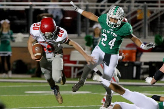 Freshman Ethan Twilligear of Holliday jumps over the legs of a Clifton defender Friday night in Mineral Wells as the Holliday Eagles took on the Clifton Cubs in playoff action.