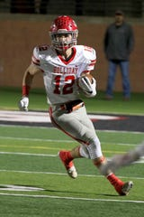 Conner Cox of Holliday takes the carry for a gain Friday night in Mineral Wells as the Holliday Eagles took on the Clifton Cubs in playoff action.