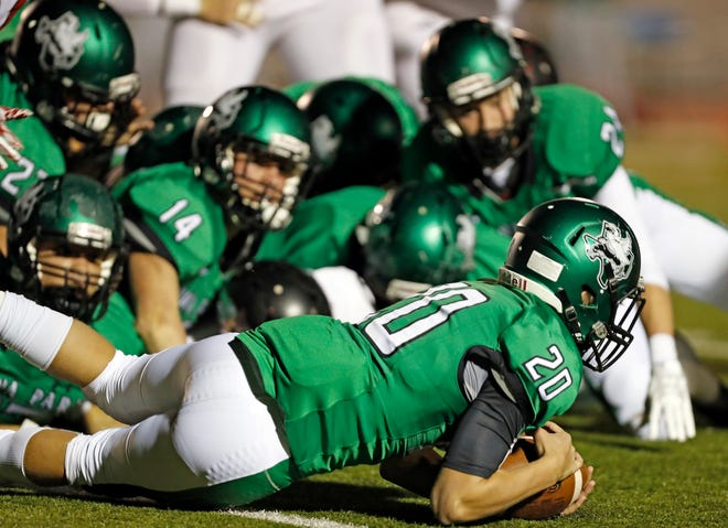 Iowa Park's Kade Thomas (20) dives on a fumble during the area round playoff game against Levelland, Friday, Nov. 23, 2018, at Tiger Stadium in Snyder, Texas.