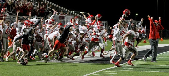 Holliday's side line erupts in celebration after the field goal that beat Clifton on Friday night.
