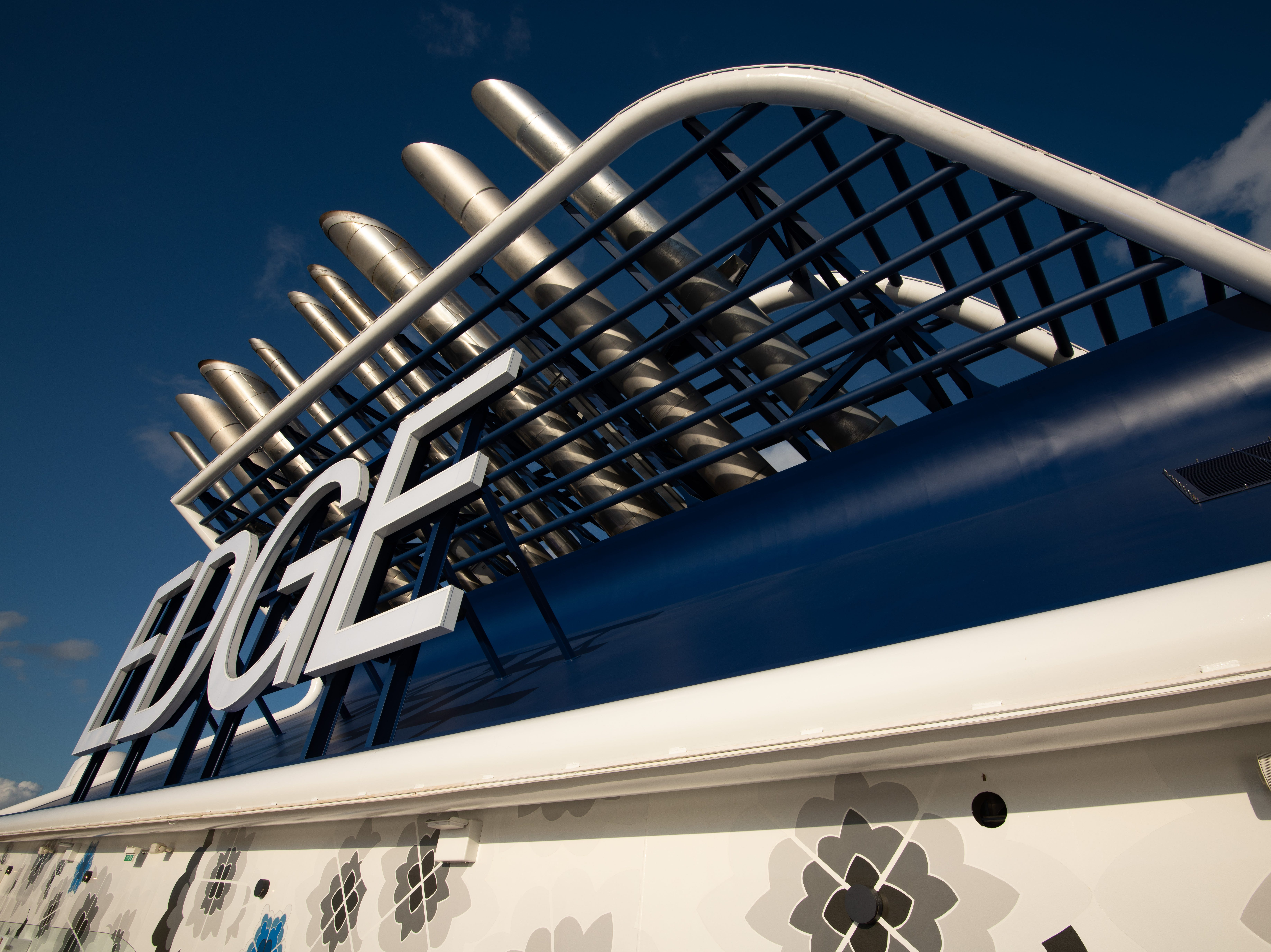 Celebrity Edge's name is spelled out in big white letters on the sides of ship's funnel.