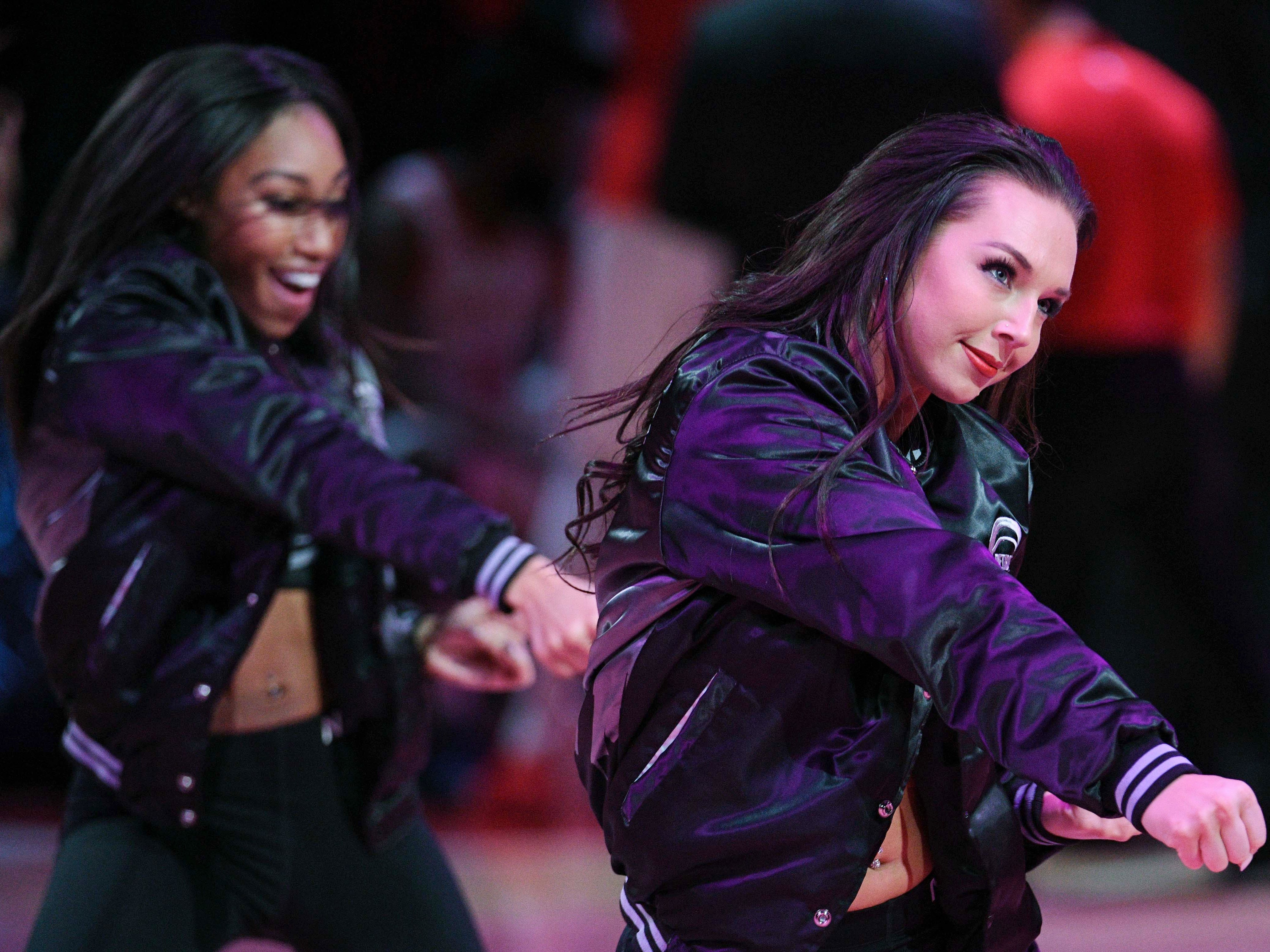 Nov. 23: Pistons dancers perform against the Rockets.