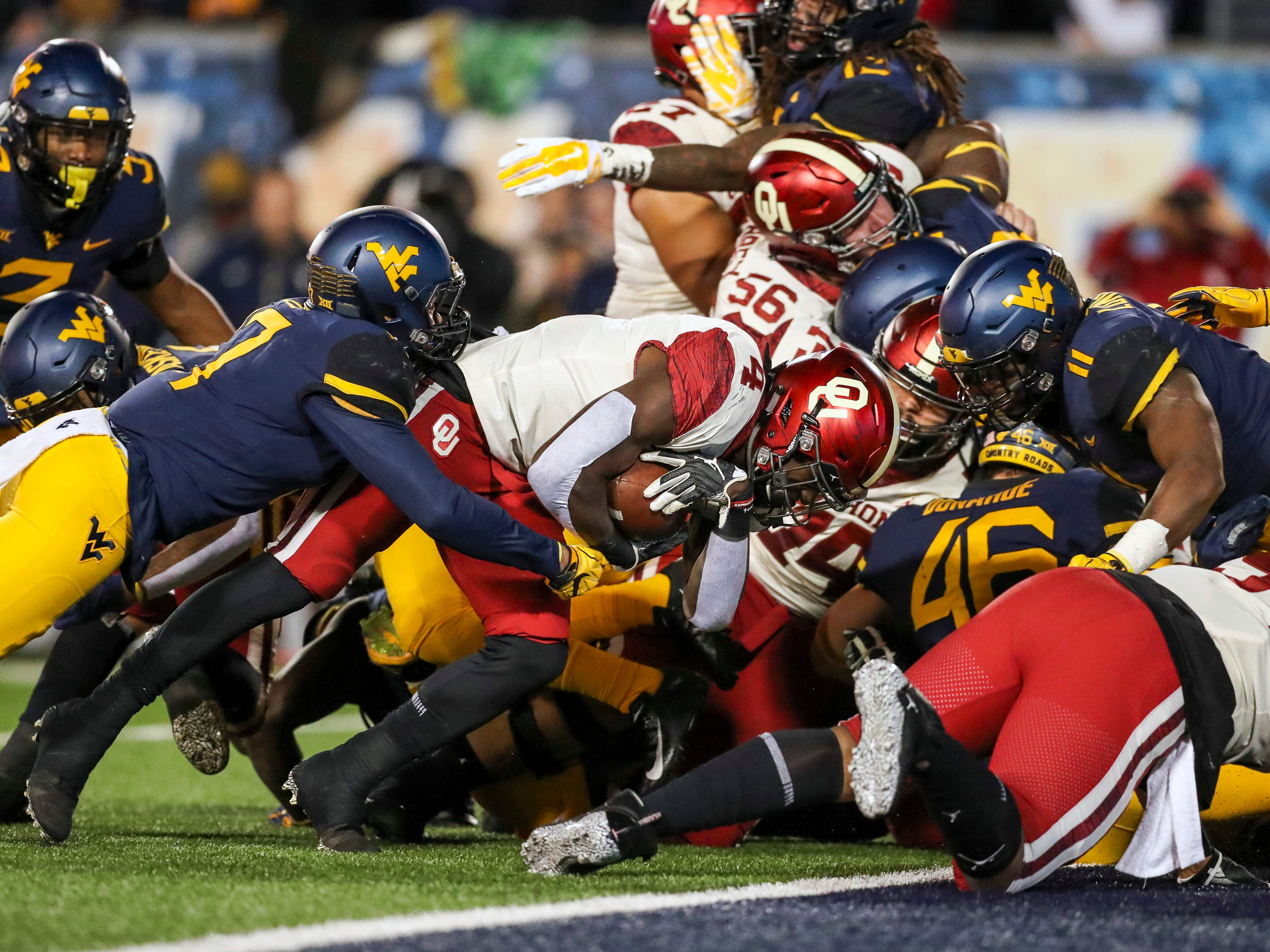 Oklahoma running back Trey Sermon carries for a touchdown during the second quarter against West Virginia.