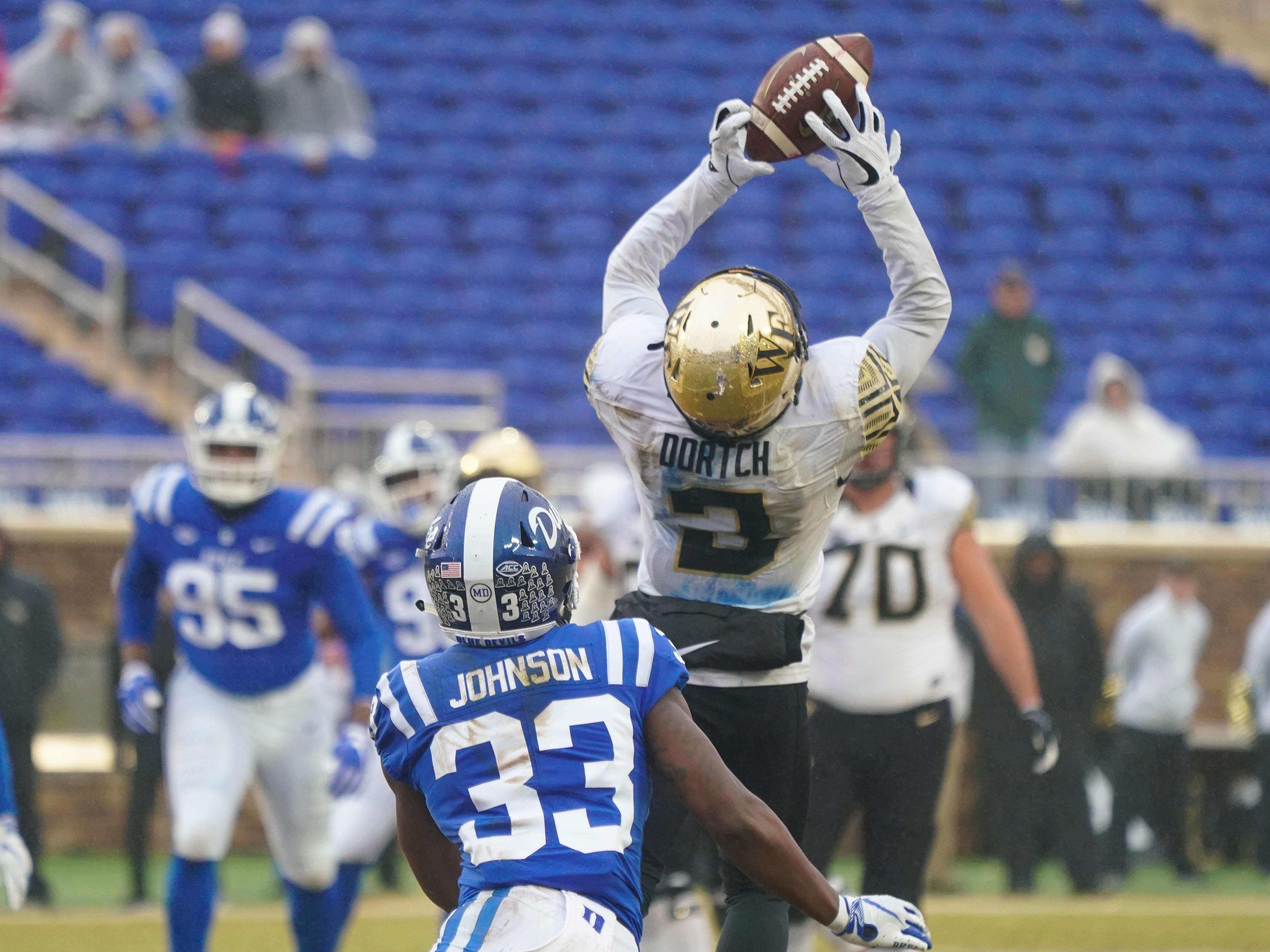 Wake Forest Demon Deacons wide receiver Greg Dortch (3) makes a first-half catch against Duke Blue Devils safety Leonard Johnson (33) at Wallace Wade Stadium.
