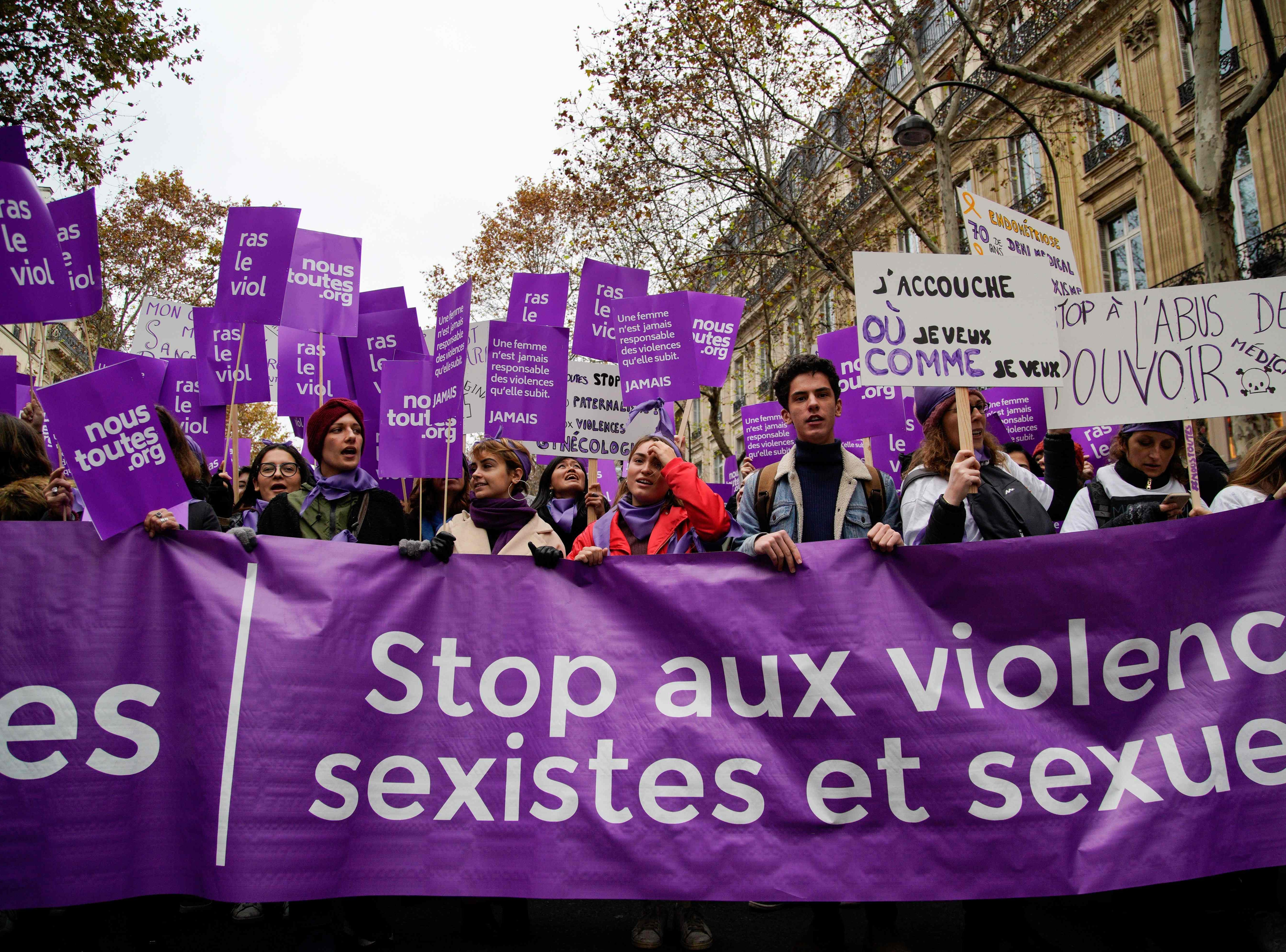 Participants walk with a banner reading 'Stop sexist and sexual violence' as they take part in a rally in Paris on Nov. 24, 2018, marking the International Day for the Elimination of Violence against Women.