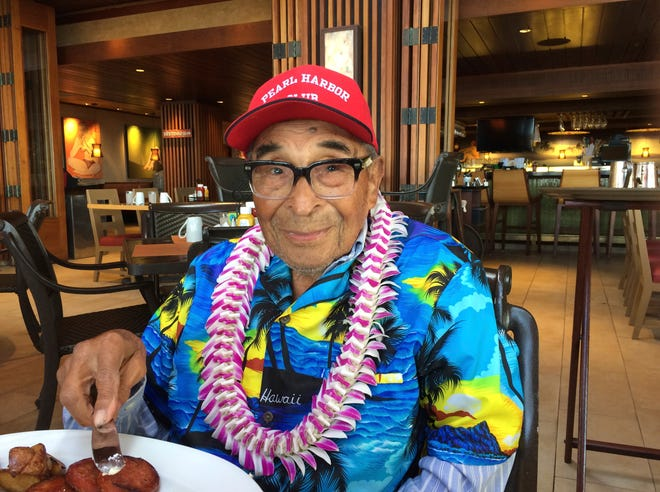 In this Dec. 5, 2016, file photo, Ray Chavez, a Pearl Harbor survivor from Poway, Calif., poses for a photo as he was eating breakfast in Honolulu.