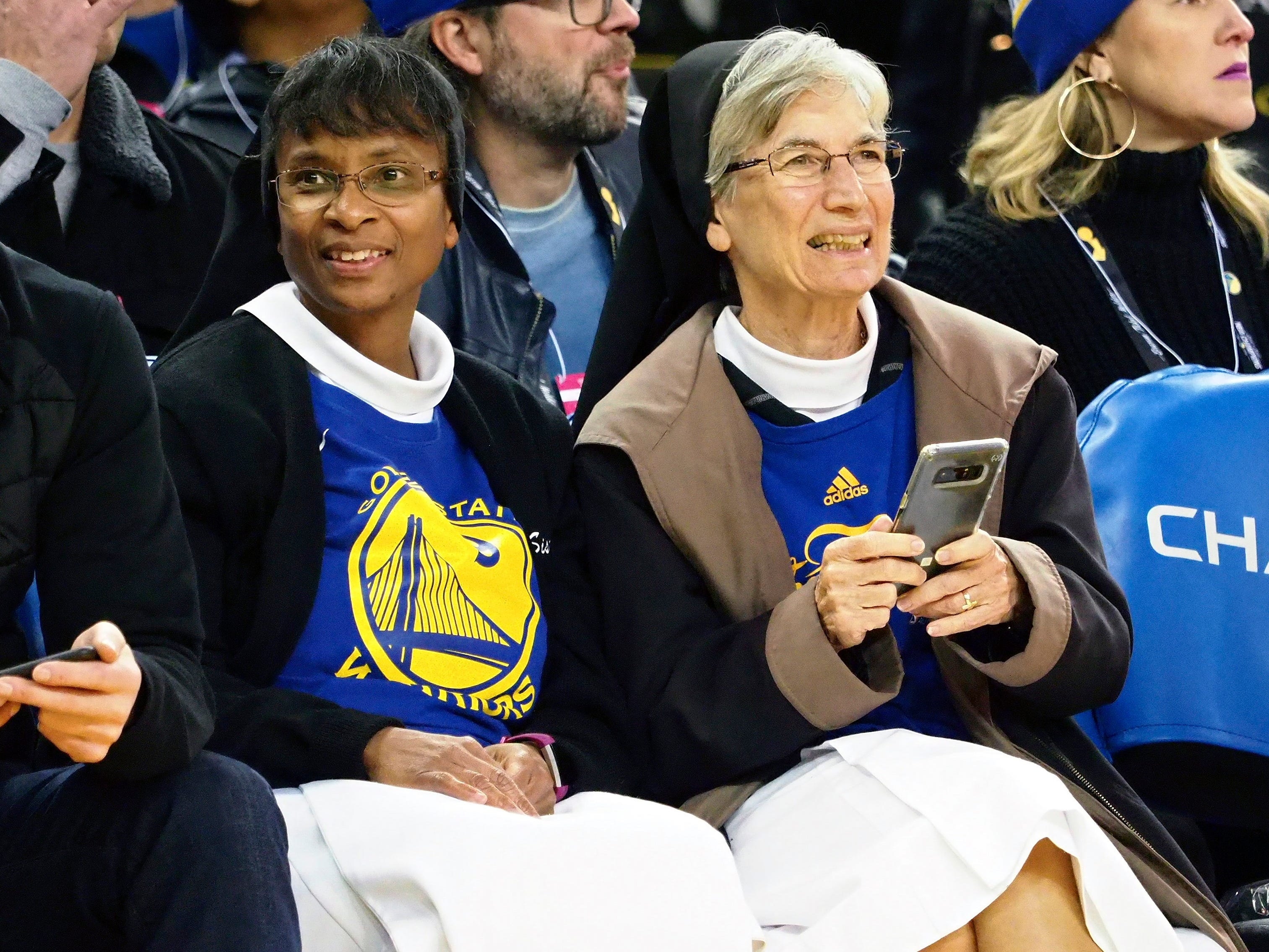 Nov. 23: A pair of faithful fans takes in the Warriors-Blazers game at Oracle Arena.