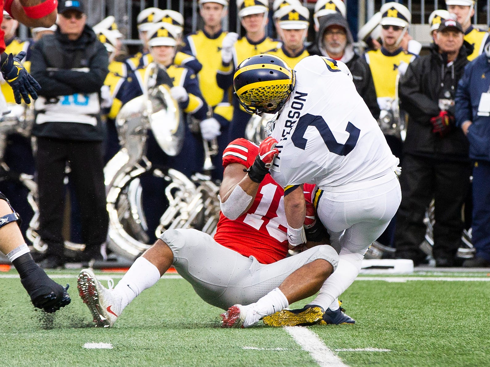 Ohio State Buckeyes defensive end Jonathon Cooper (18) sacks Michigan Wolverines quarterback Shea Patterson (2) in the first half at Ohio Stadium.