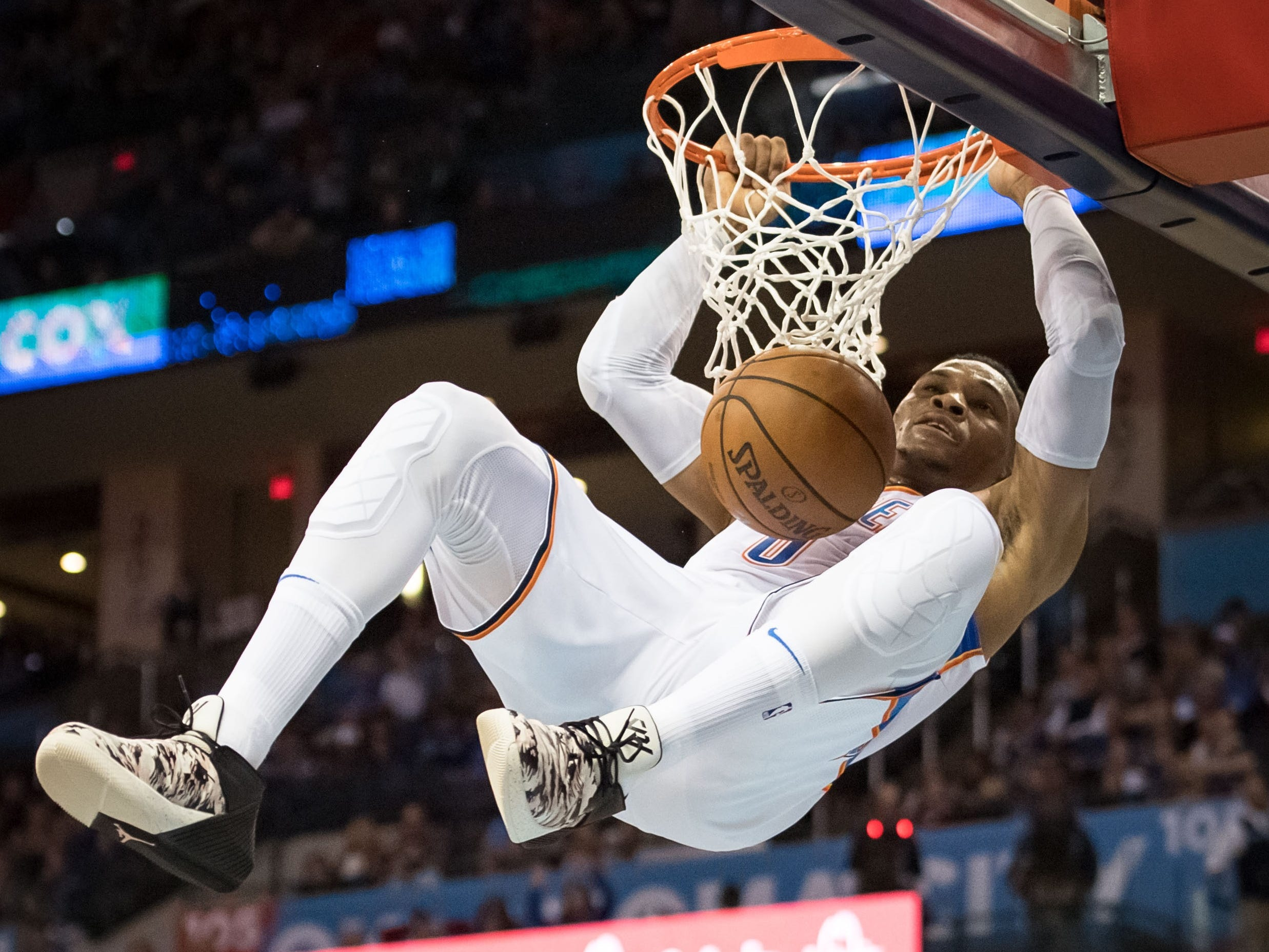 Nov. 23: Thunder guard Russell Westbrook throws down a two-handed slam with authority during the second half against the Hornets in Oklahoma City.