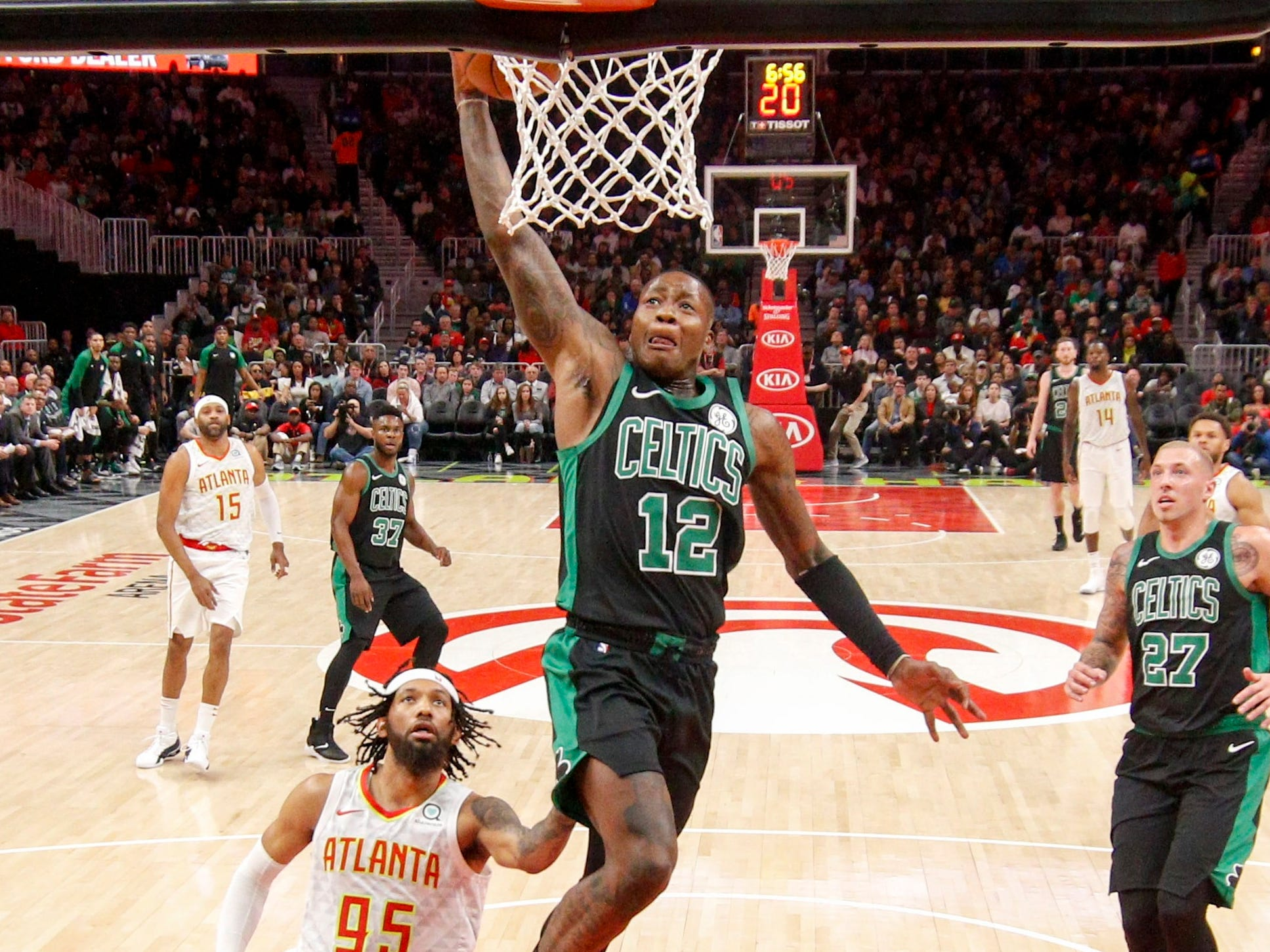 Nov. 23: Celtics guard Terry Rozier finishes the break with a one-handed flush during the first half against the Hawks in Atlanta.