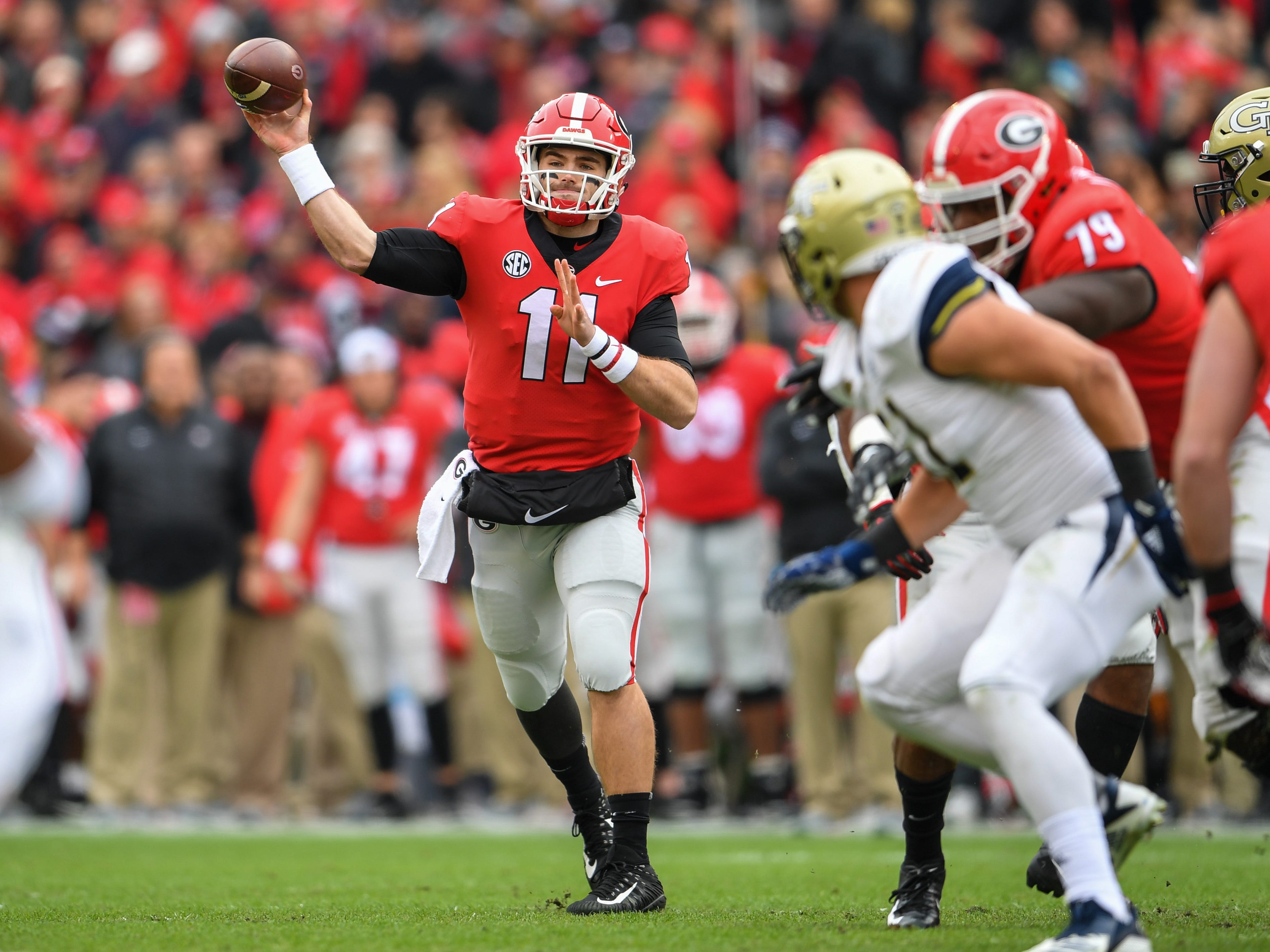 Georgiaquarterback Jake Fromm drops back to pass against Georgia Tech during the first quarter at Sanford Stadium.
