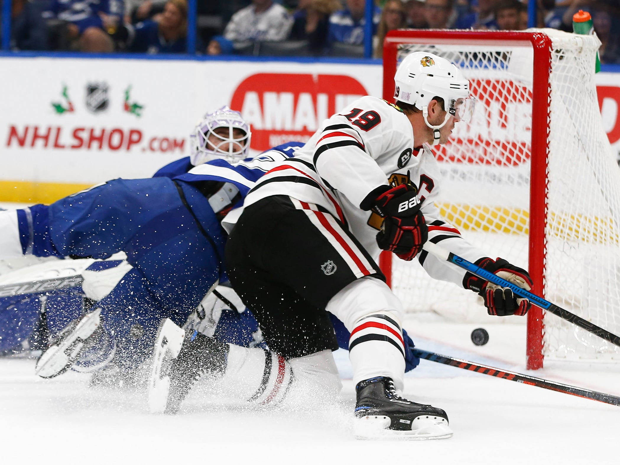 Nov. 23: Chicago Blackhawks center Jonathan Toews maneuvers to score as Tampa Bay Lightning center Brayden Point collides with goaltender Louis Domingue.