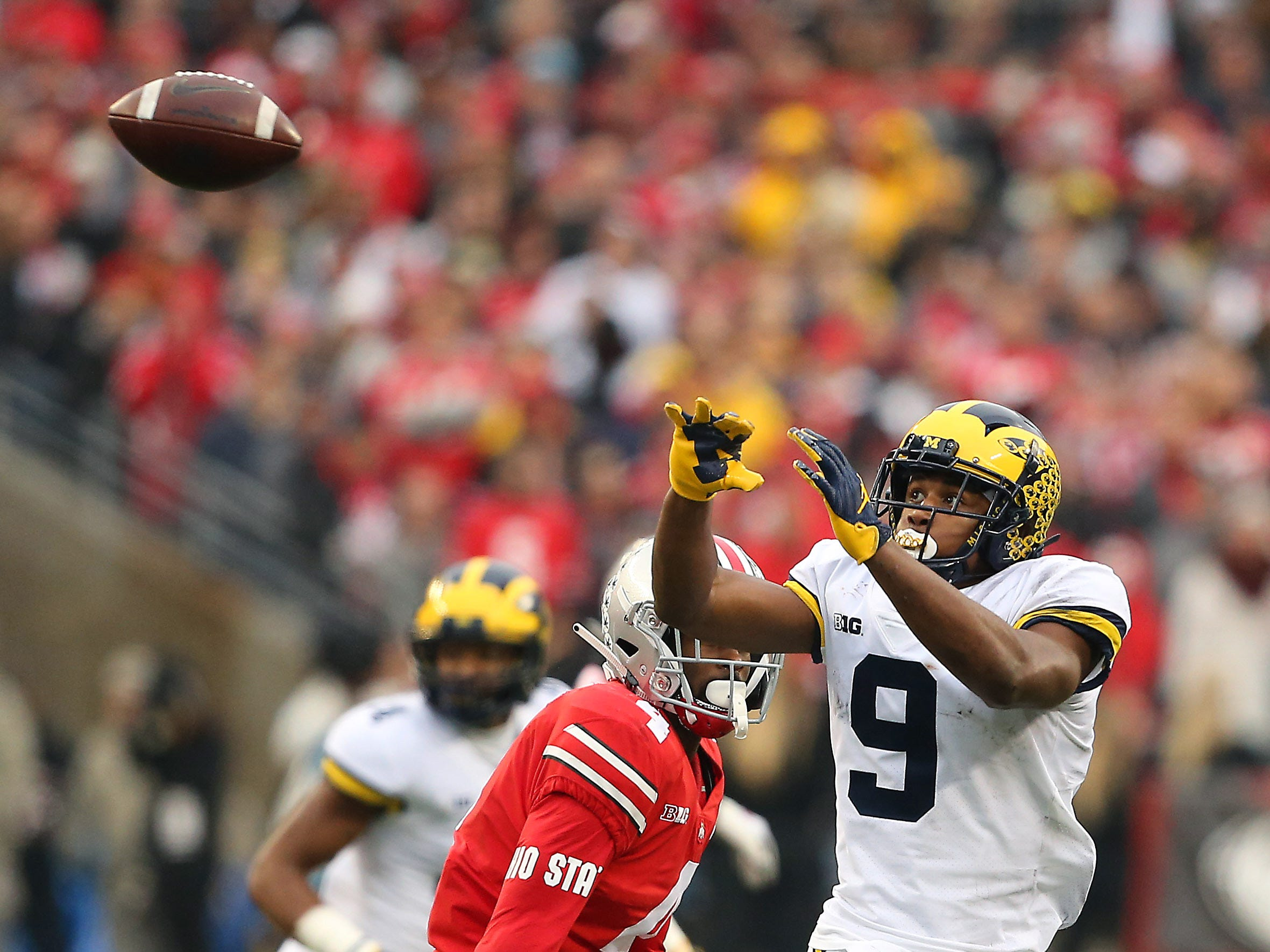 Michigan Wolverines wide receiver Donovan Peoples-Jones (9 ), about to catch a second-quarter pass in front of Ohio State Buckeyes safety Jordan Fuller (4) during the second quarter at Ohio Stadium.