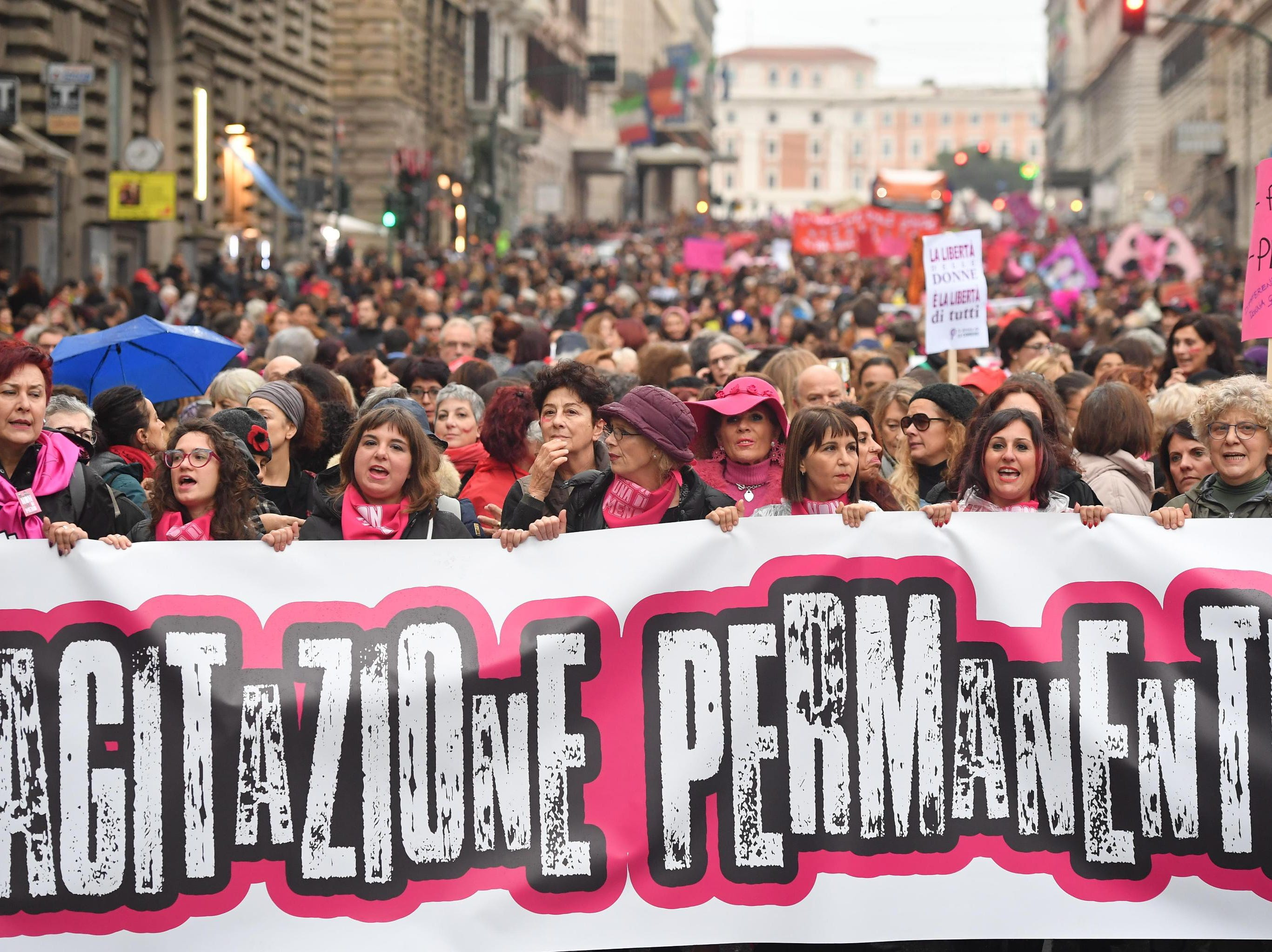 Demonstrators hold a banner reading 'Permanent Agitation,' as they attend a rally on the eve of the International Day for the Elimination of Violence against Women, in Rome, Italy on Nov. 24, 2018.