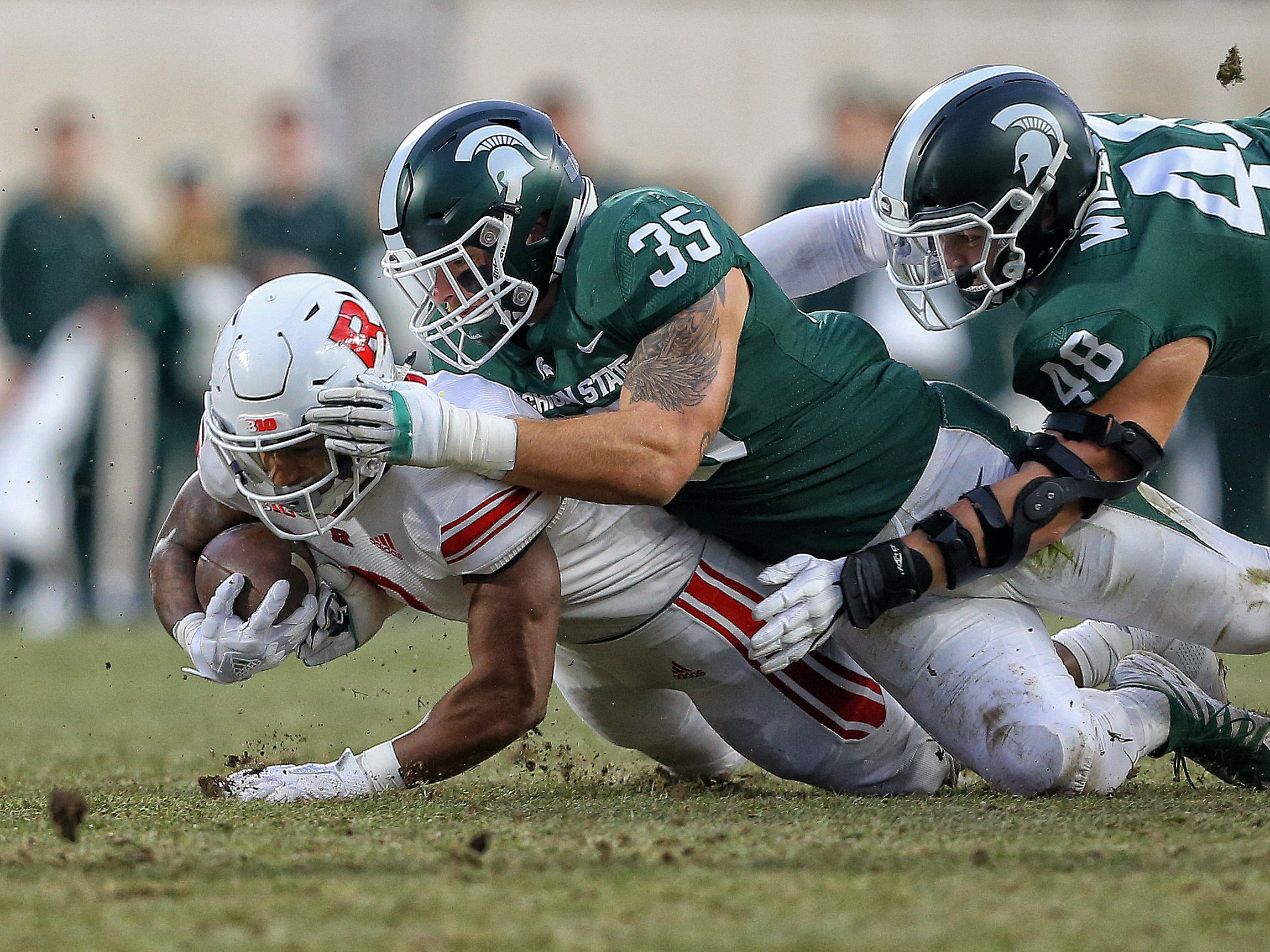 Rutgers Scarlet Knights running back Raheem Blackshear (2) is tackled by Michigan State Spartans linebacker Joe Bachie (35) during the first quarter of a game at Spartan Stadium.