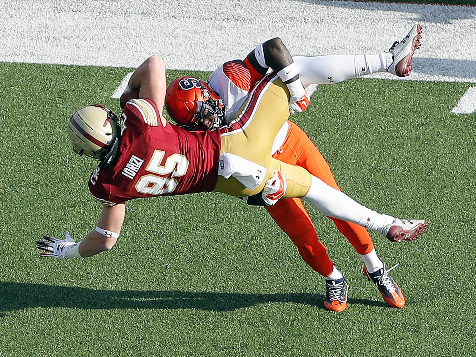 Syracuse defensive back Trill Williams (21) brings down Boston College tight end Korab Idrizi (85) the first half at Alumni Stadium.