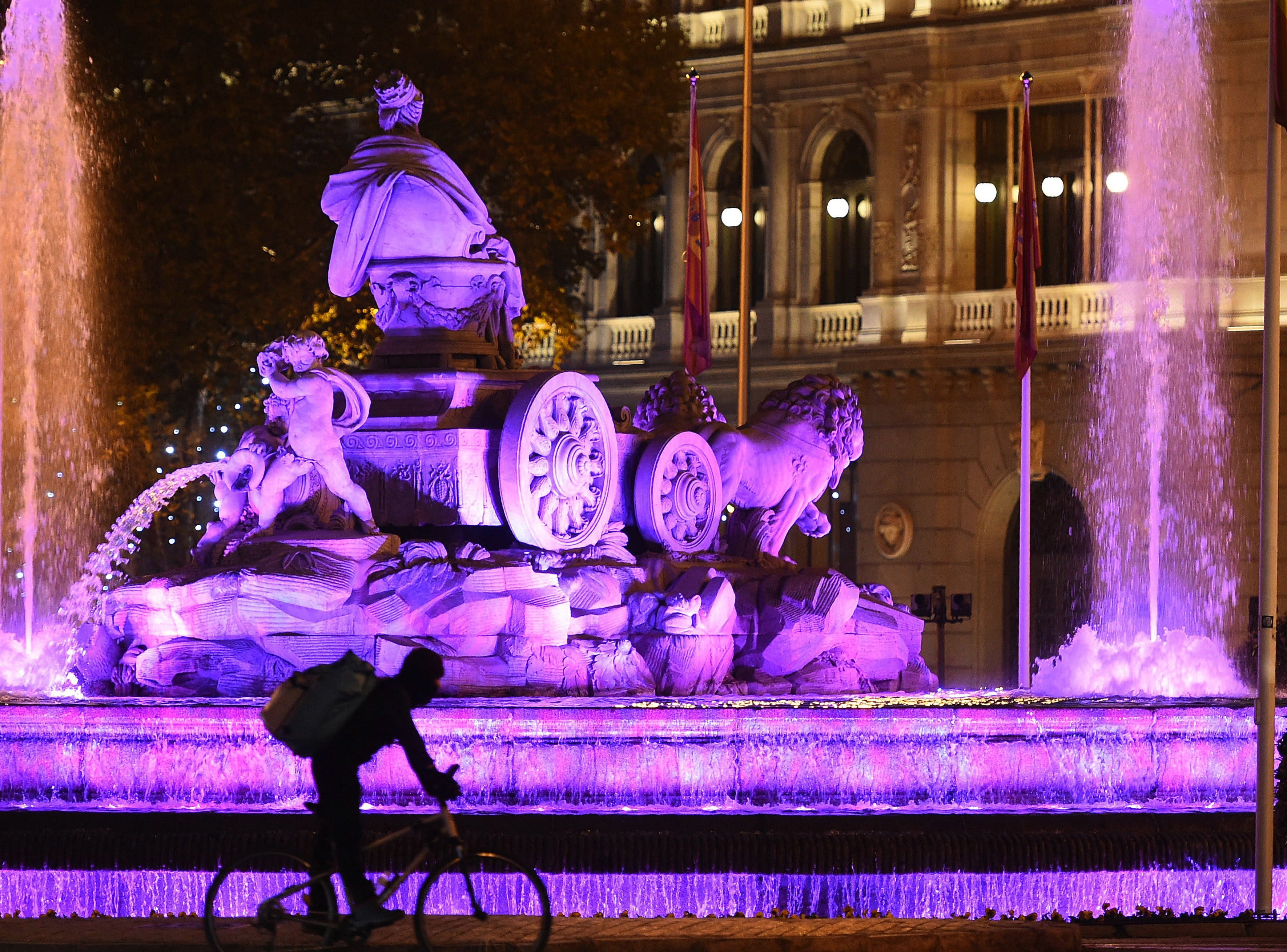 The Cibeles Fountain is lit up with purple lights on the occasion of the International Day for the Elimination of Violence against Women in Madrid, Spain, Nov. 24, 2018.