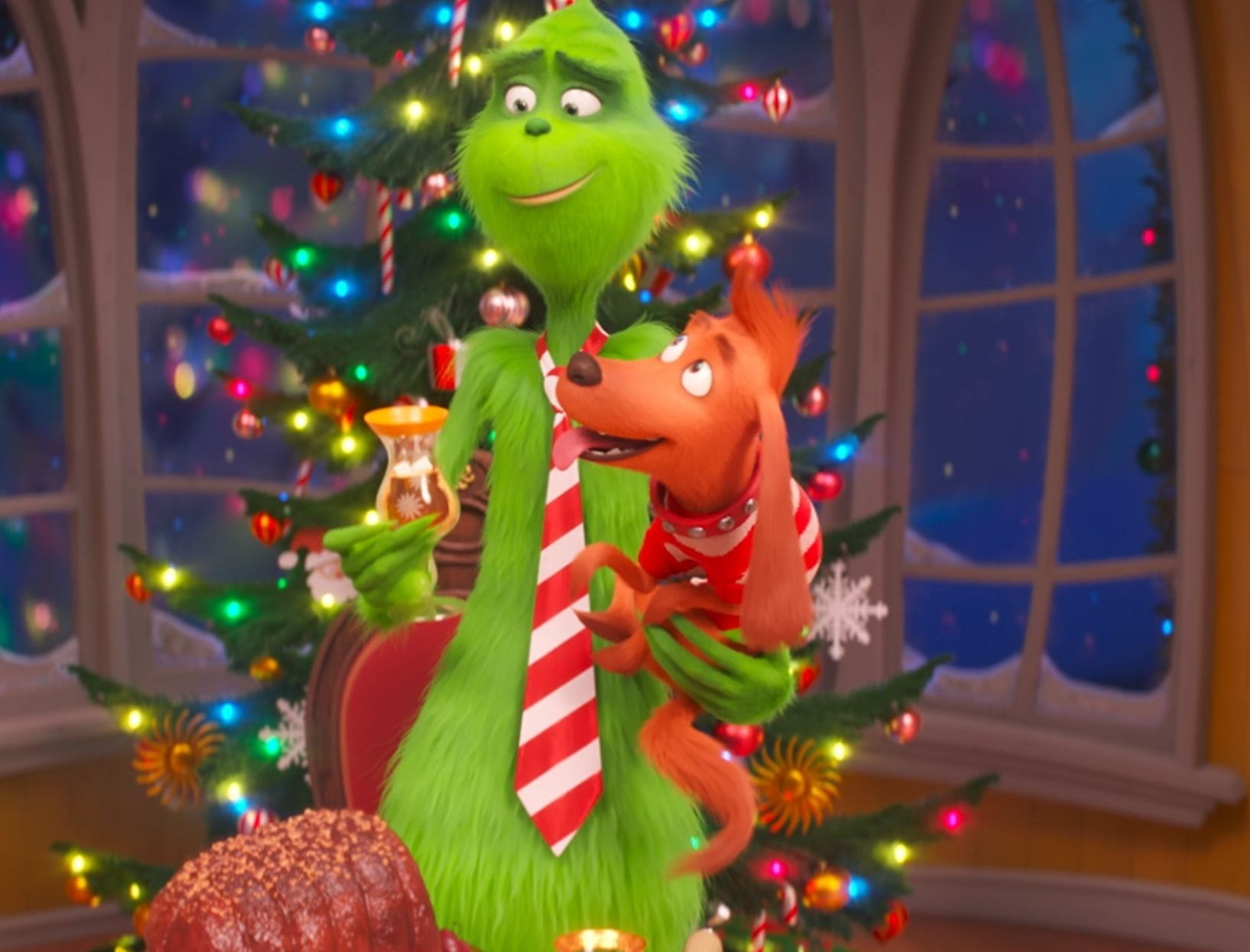 "The Grinch (voiced by Benedict Cumberbatch) and Max are the life of the party in ""The Grinch."""