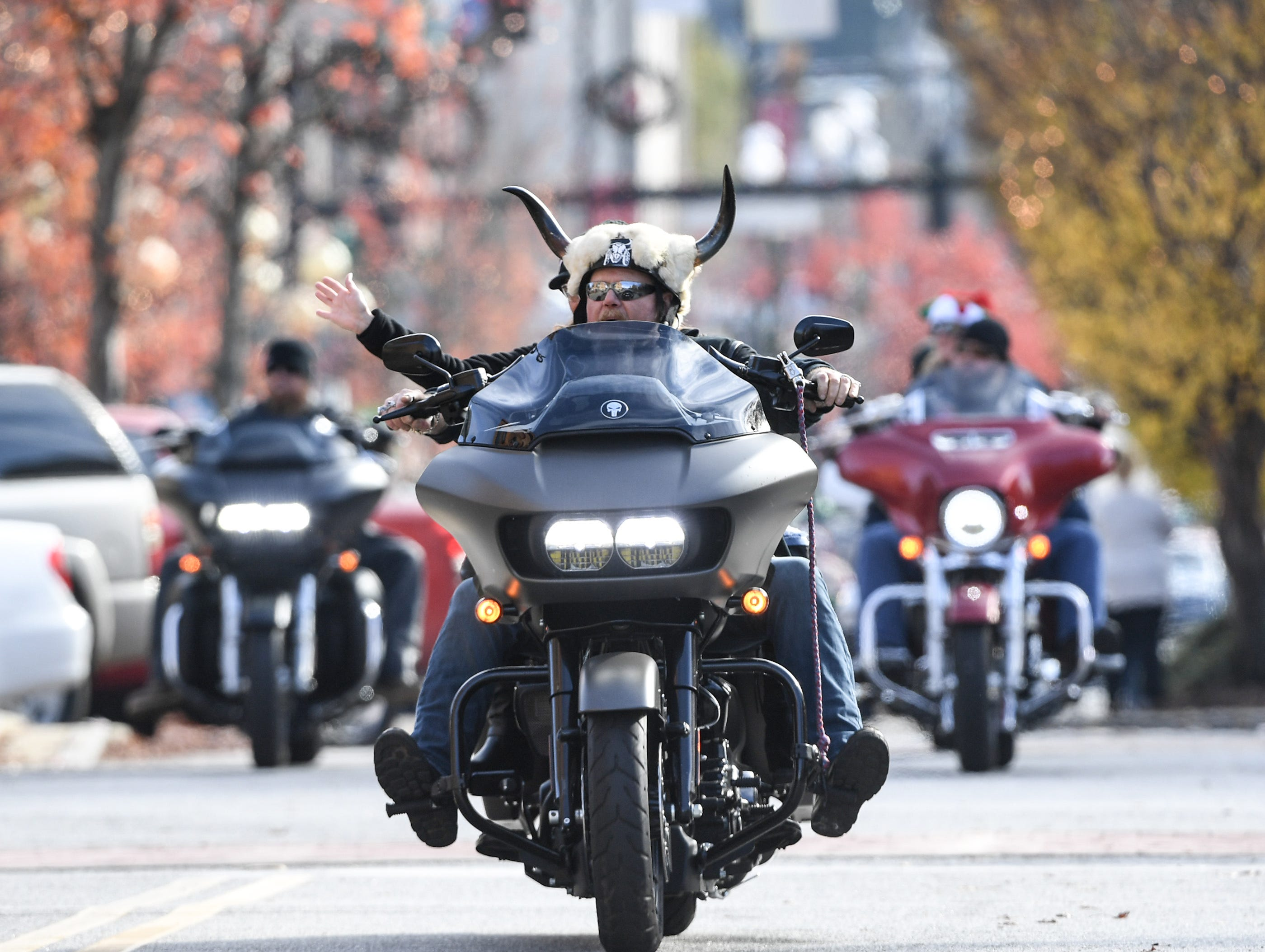 Motorcyclists ride in the 38th Jack Hurley Toy Parade in Anderson on Sunday, November 25, 2018. The parade started at White Jones Hardware parking lot in the Watson Village, followed along Main Street to the Civic Center of Anderson where toys were donated to Anderson Cares and Shares, helping 350 families with Christmas gifts. The Anderson Toy Parade is also in memory of Charles and Diane Bolt.