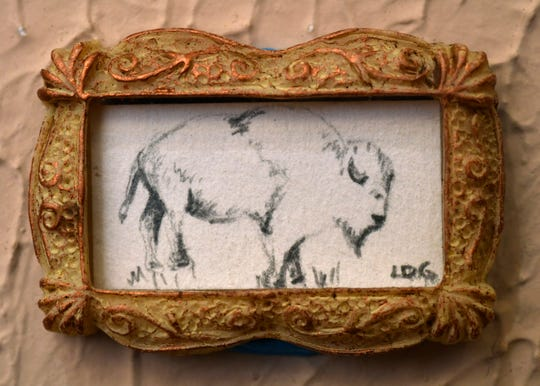 "Laura Greenwood's ""White Bison"". Greenwood is the manager for the 1818 Arthouse which is holding its ""Tiny Art!"" show in Snyder until Dec. 22."