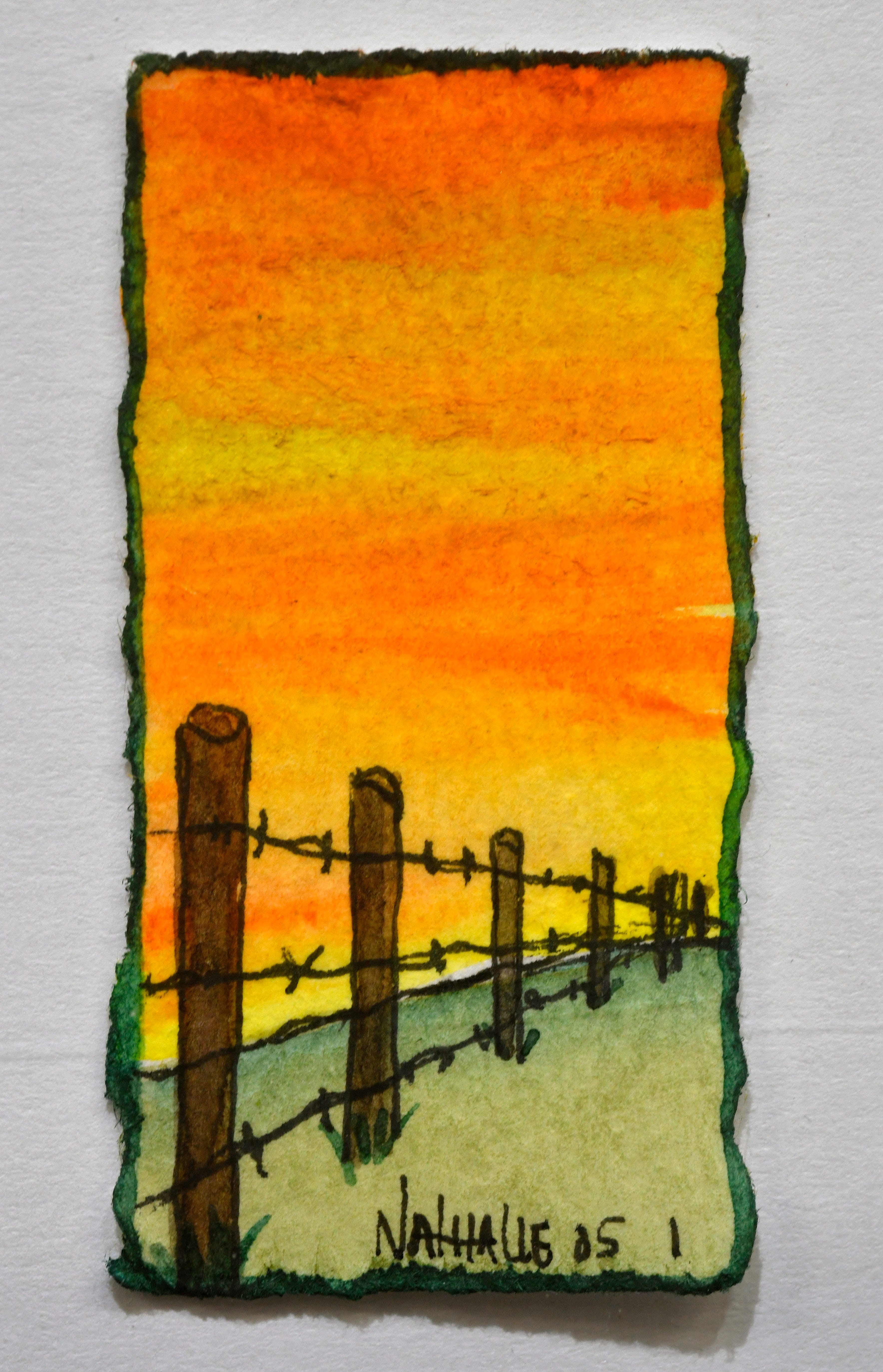 """Nathalie Kelley's """"Fence Posts"""", a watercolor painting about two inches tall, on display at the 1818 Arthouse."""