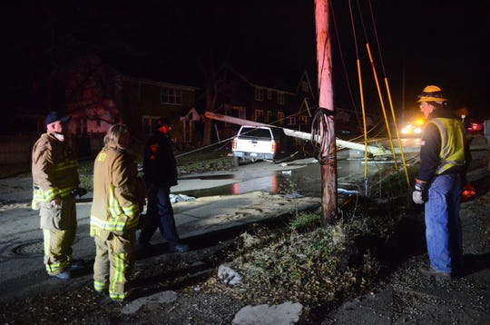 A woman was arrested after her pick-up hit a power pole on Terrace Avenue about 5:25 a.m. Sunday.