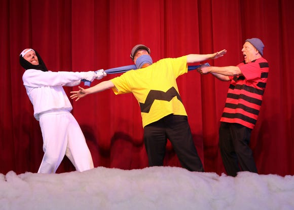 Charlie Brown (Scott Snively, middle) finds himself the rope in a tug-of-war between Snoopy (Marcus Hickerson, left) and Linus (Ron McClung).