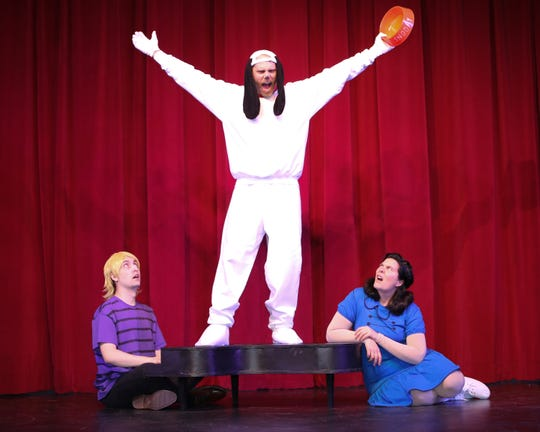 Snoopy (Marcus Hickerson, middle) comes between Schroeder (Cameron Reeves) and Lucy (Hannah Jones).