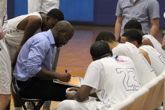 Anthony Barringer draws up a play for the Warren Wilson College Owls during a home game against Mars Hill on Nov. 25. The head coach announced he was stepping down after four seasons in that role.