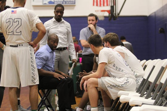 Warren Wilson College head men's basketball coach Anthony Barringer talks to his players during a timeout in a home game against Mars Hill University. The Owls, which play in the USCAA Division II, announced on March 13, they would begin transitioning to NCAA Division III.