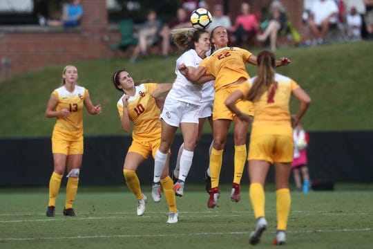FSU's Olivia Bergau fights against the University of Southern California's Ashleigh Plumptre for the header during their match at the Seminole Soccer Complex on Friday, Aug. 31, 2018.