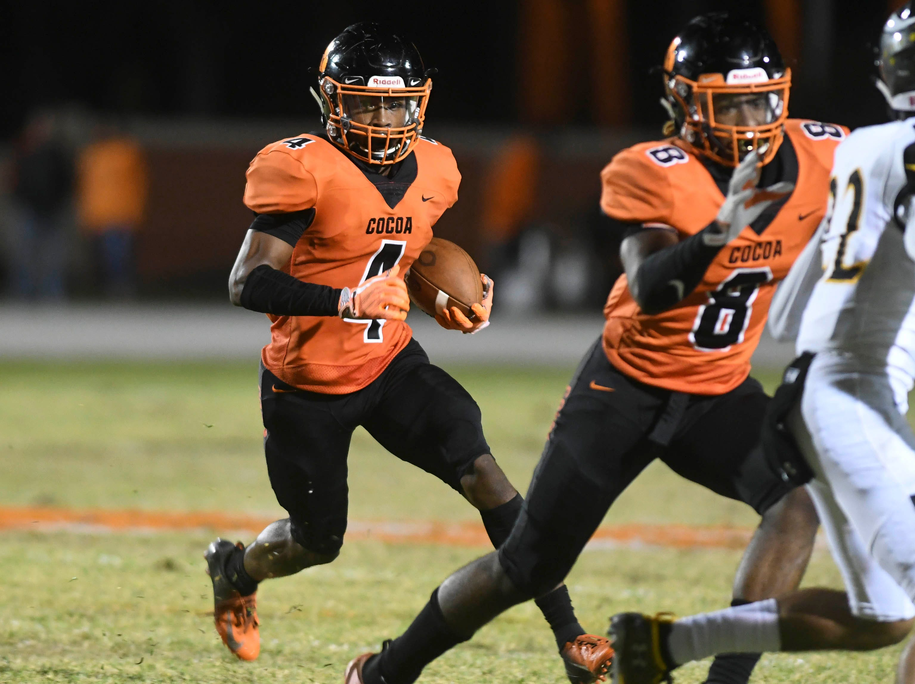 Willie Gaines of Cocoa runs the ball during Friday's game at Blake Stadium.