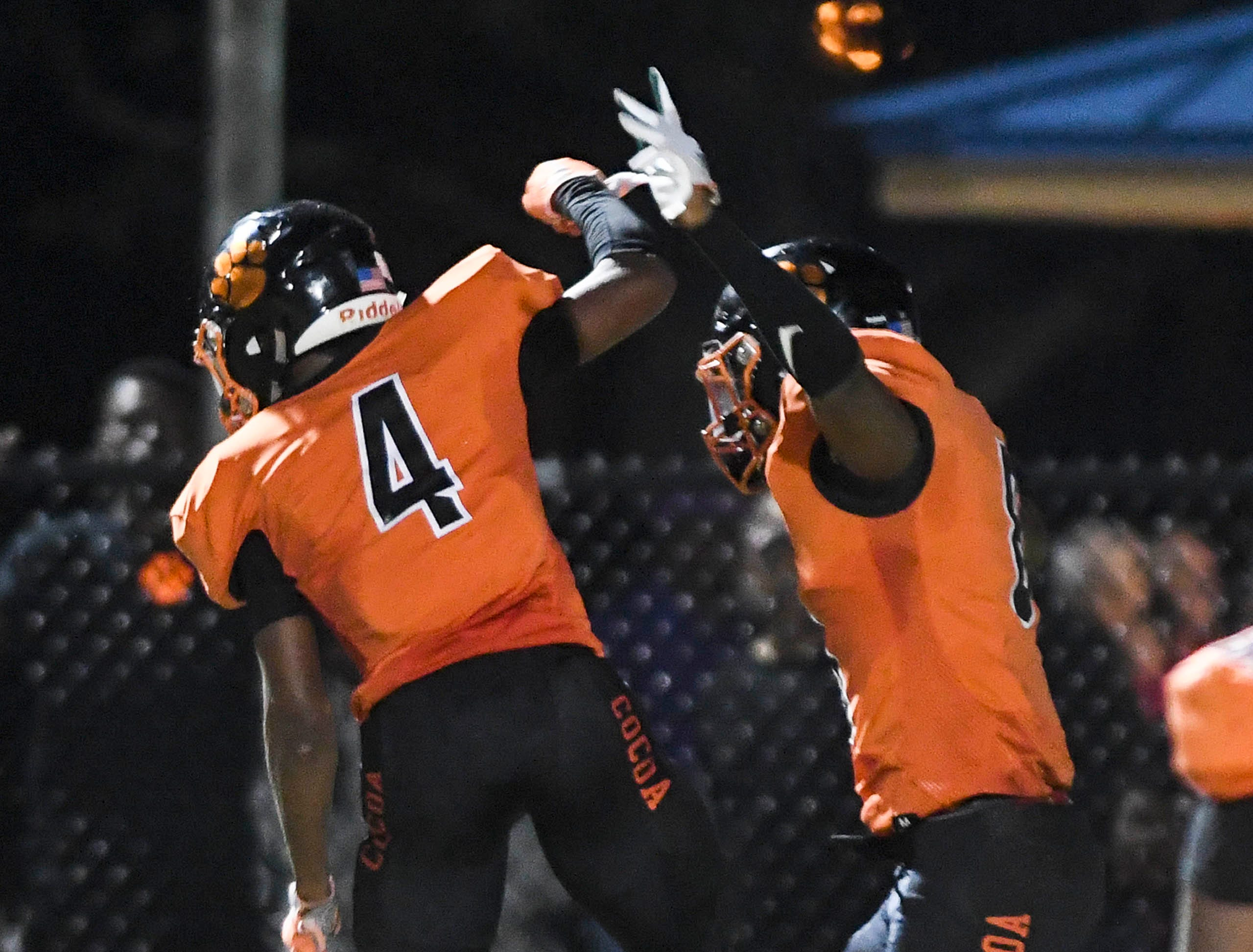 WIllie Gaines and Caziah Holmes of Cocoa celebrate a touchdown during Friday's game at Blake Stadium.