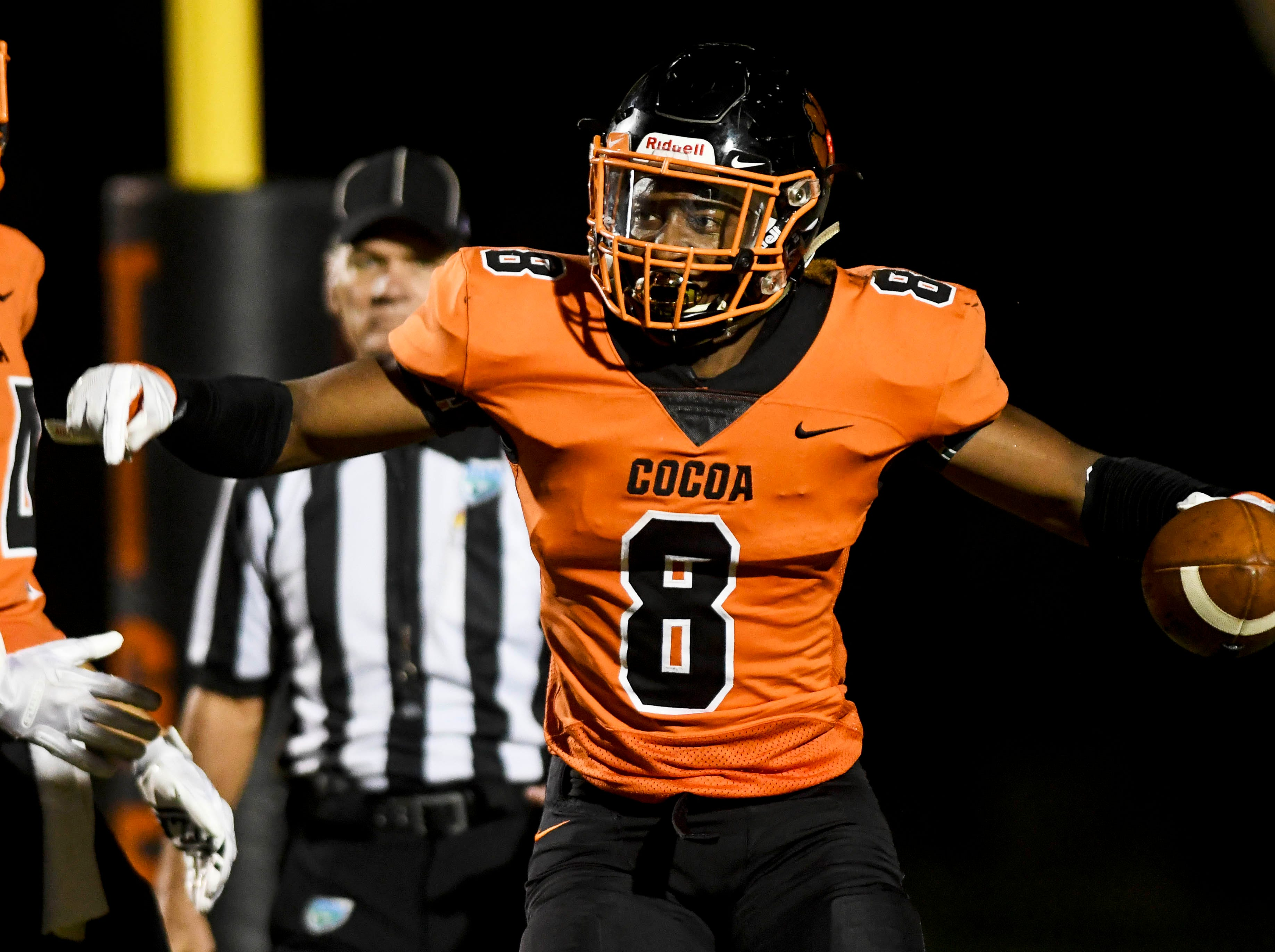 Caziah Holmes of Cocoa celebrates a touchdown during Friday's game.