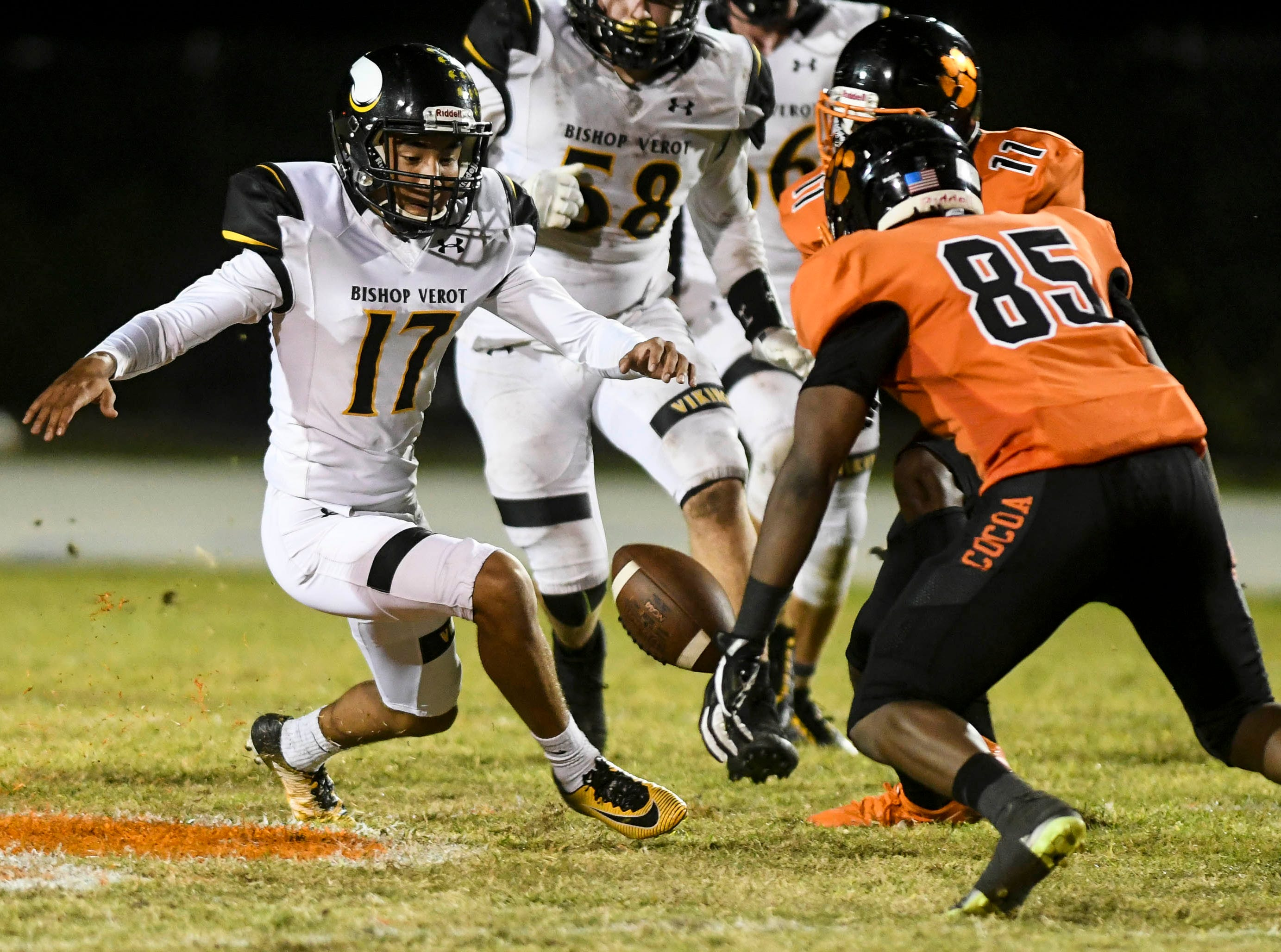 Logan Mcleod of Bishop Verot and Cocoa's Demarquez Henley vie for an onside kick during Friday's game at Blake Stadium.
