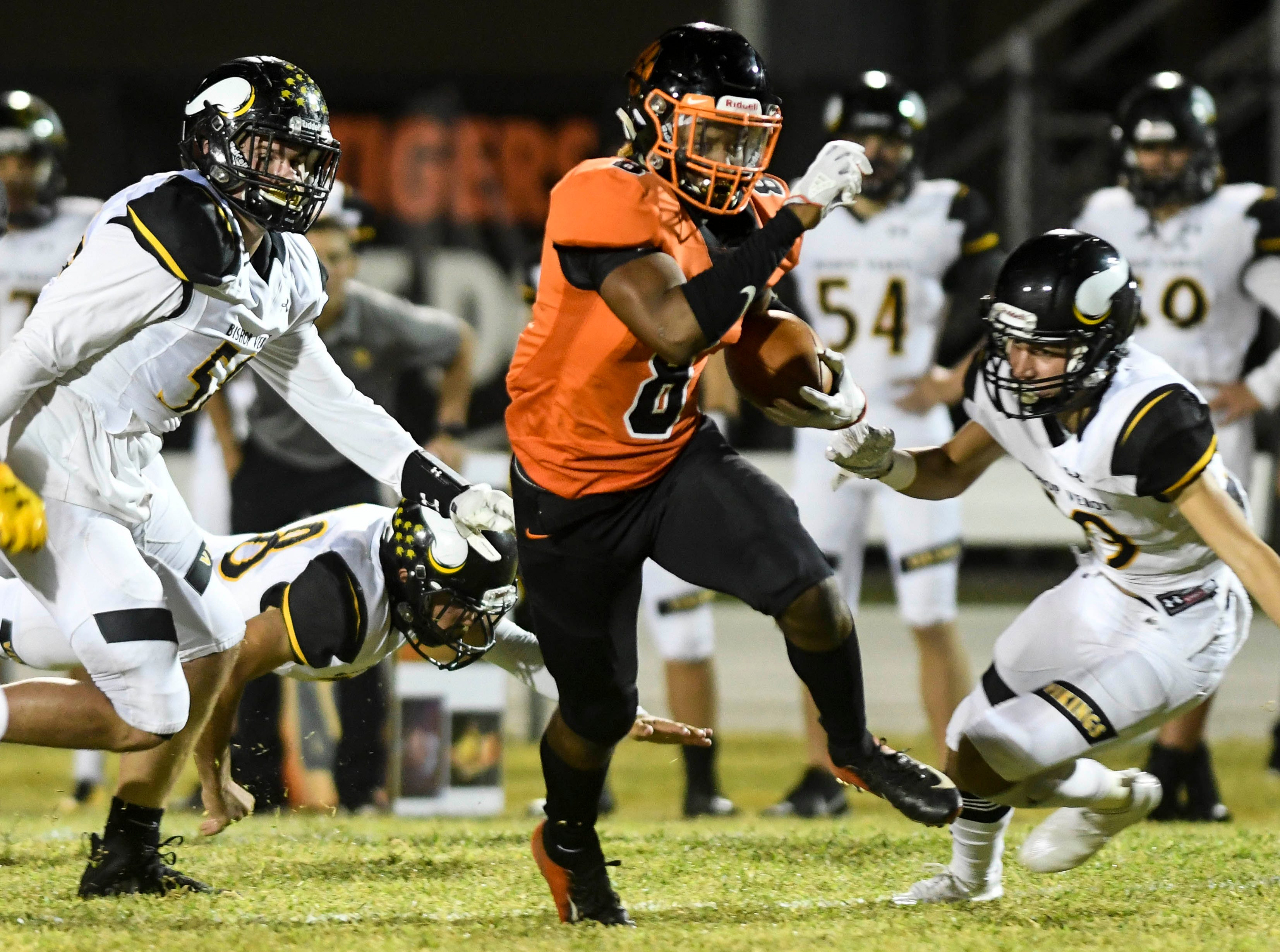 Caziah Holmes of Cocoa runs the ball during Friday's game against Cocoa.