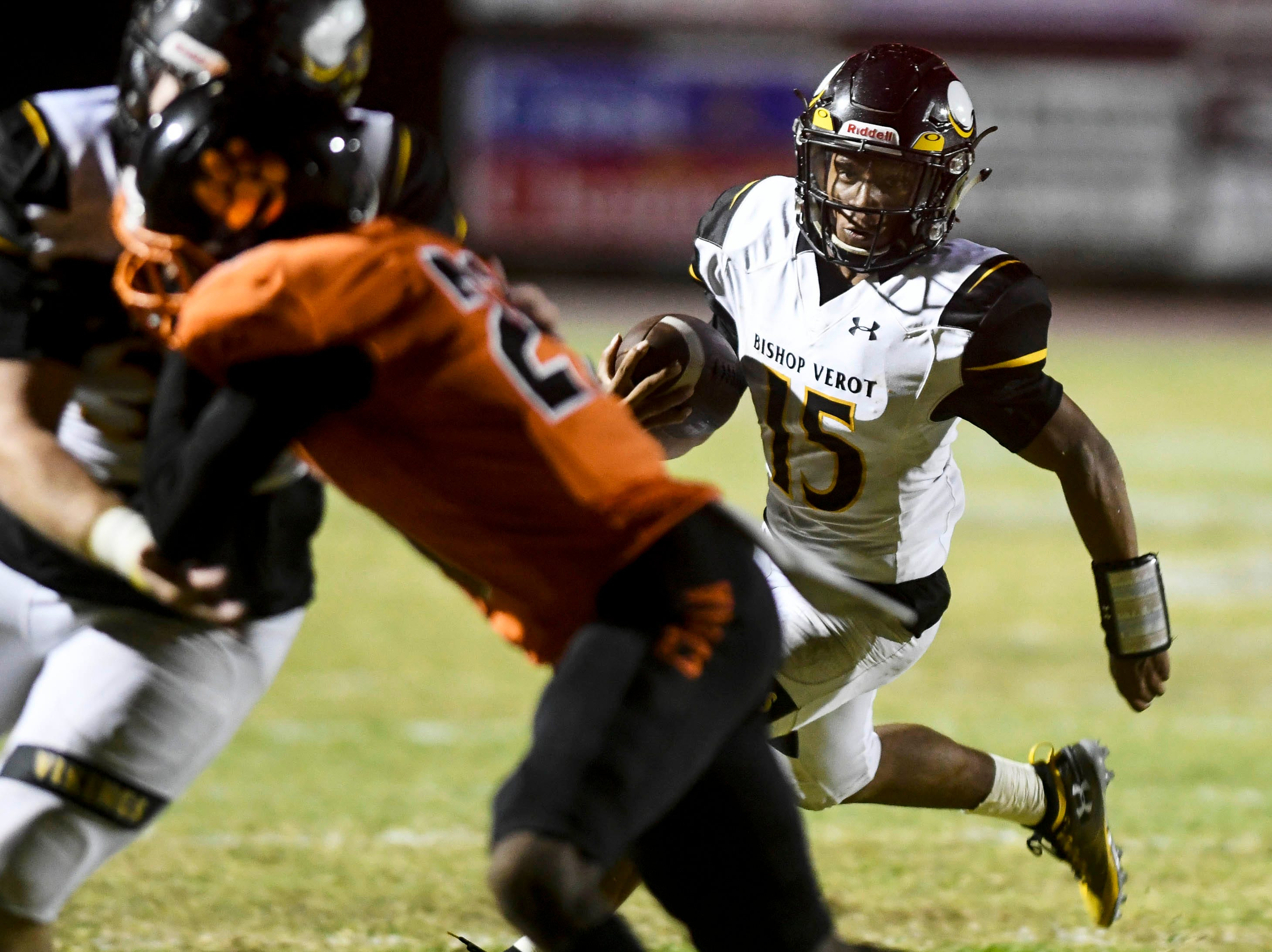 Tequon Chatman of Bishop Verot looks for running room during Friday's game in Cocoa.