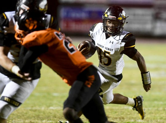 Tequon Chatman of Bishop Verot looks for running room during the Vikings' regional game at Cocoa last season.