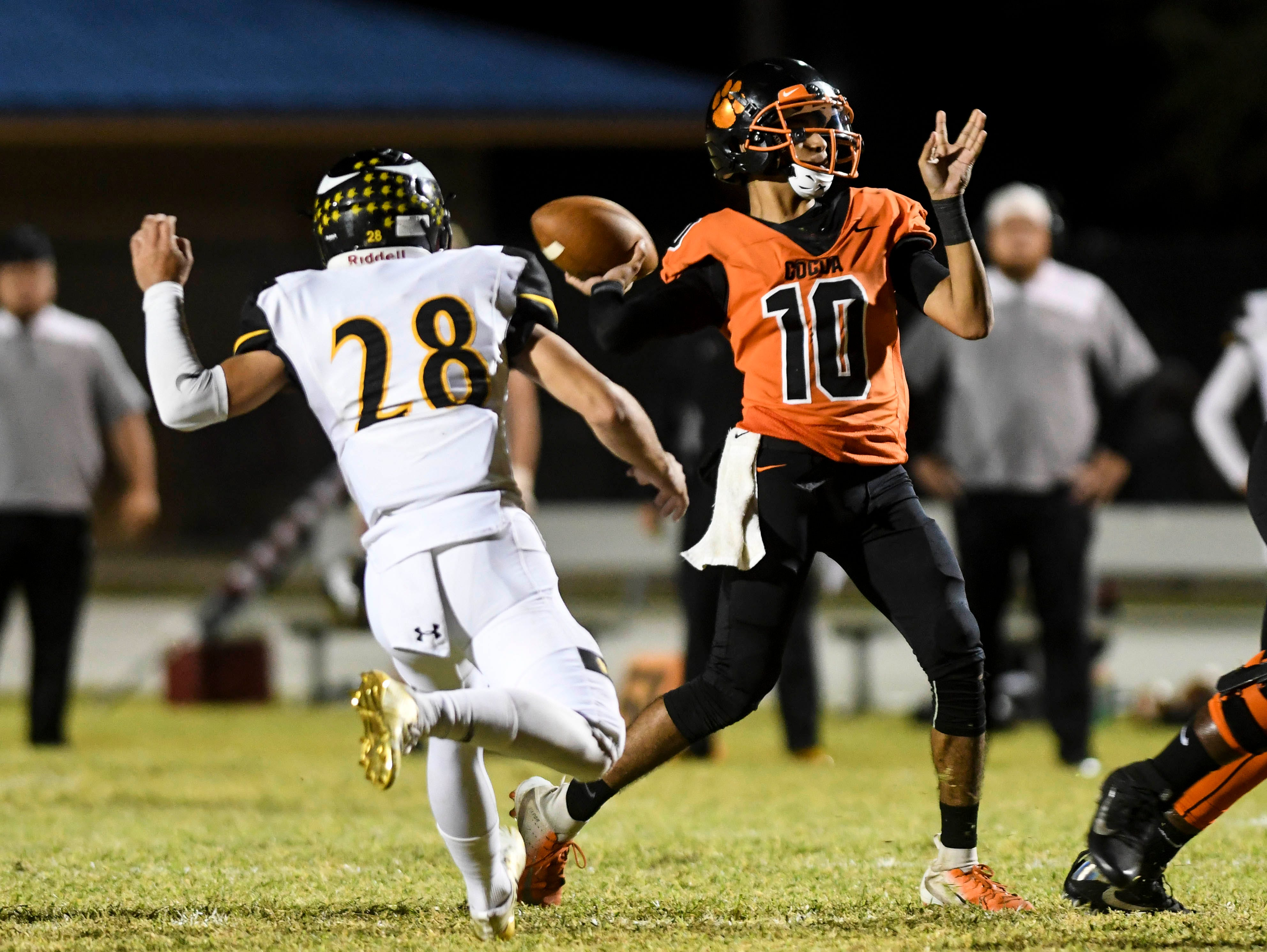 Cocoa QB Diego Arroyo passes the ball during Friday's game against Bishop Verot at Blake Stadium.