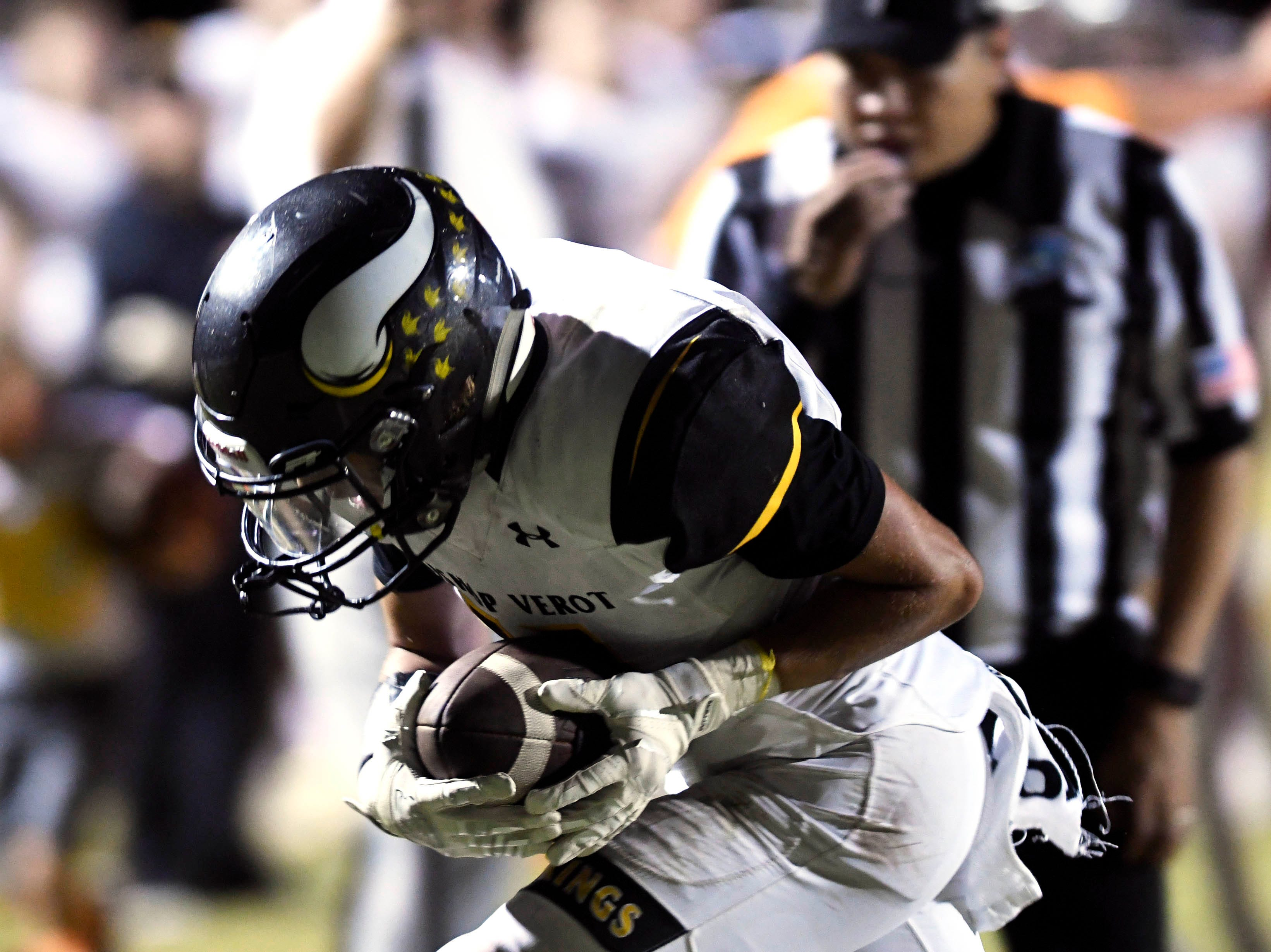 Jaidin Brown of Bishop Verot catches a pass for a touchdown during Friday's game against Cocoa.