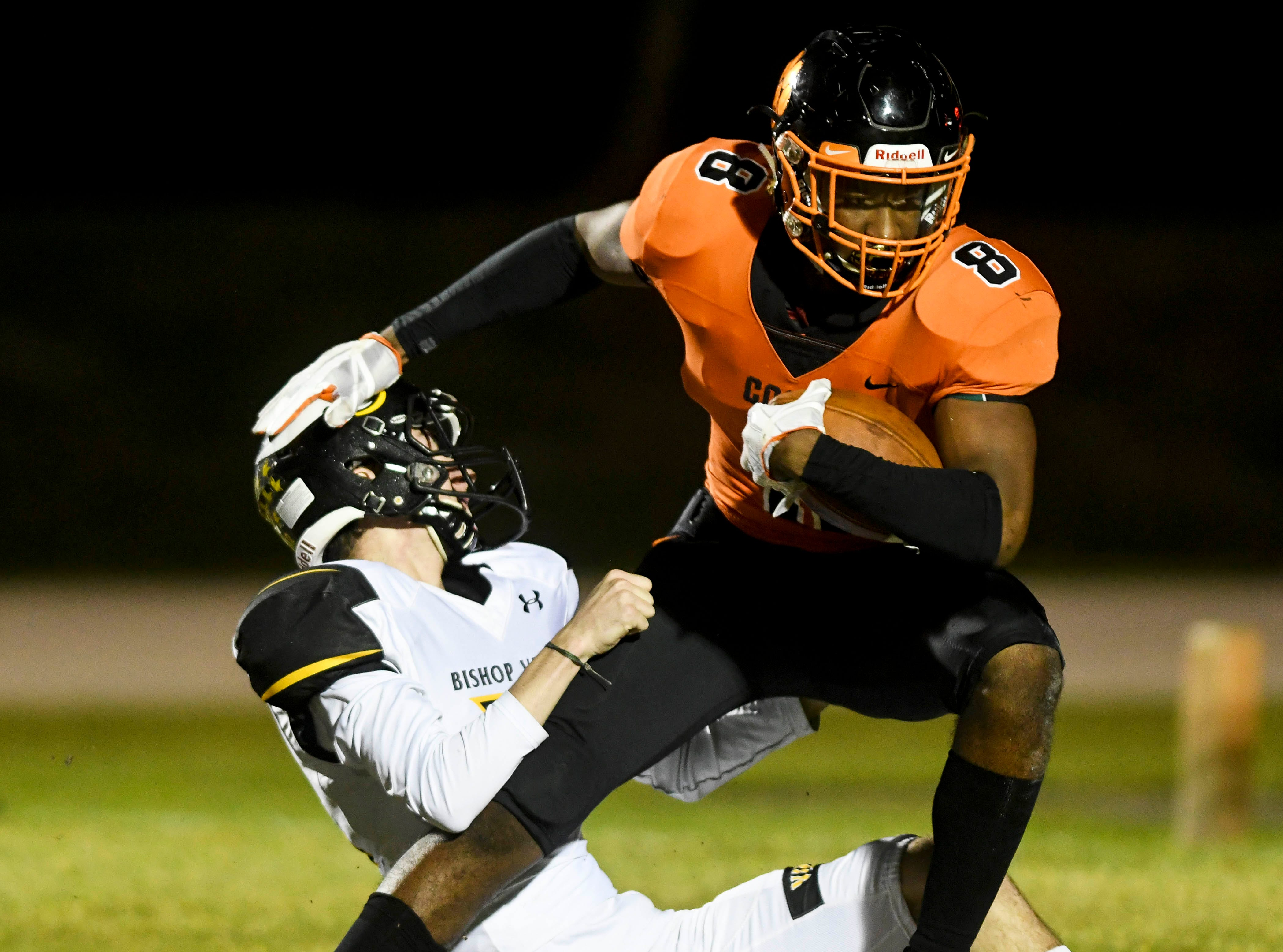 Cocoa's Caziah Holmes is dragged down by Blake Williams of Bishop Verot during Friday's game.