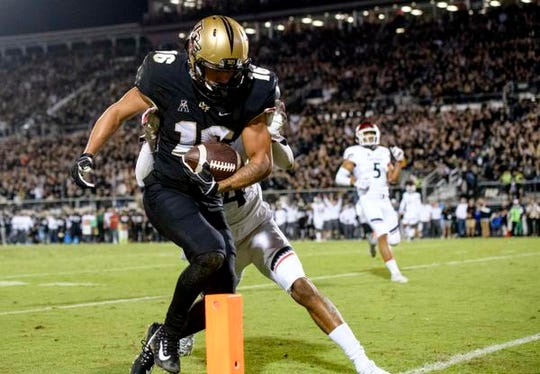Central Florida's Tre Nixon (16) runs in for a touchdown during the first half against the Cincinnati Bearcats at Spectrum Stadium.