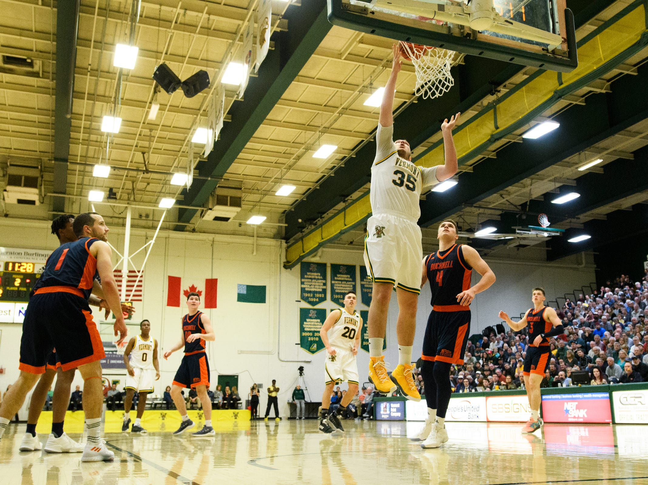 Vermont forward Ryan Davis (35) leaps for a lay up during the men's basketball game between the Bucknell Bison and the Vermont Catamounts at Patrick Gym on Sunday afternoon November 25, 2018 in Burlington.