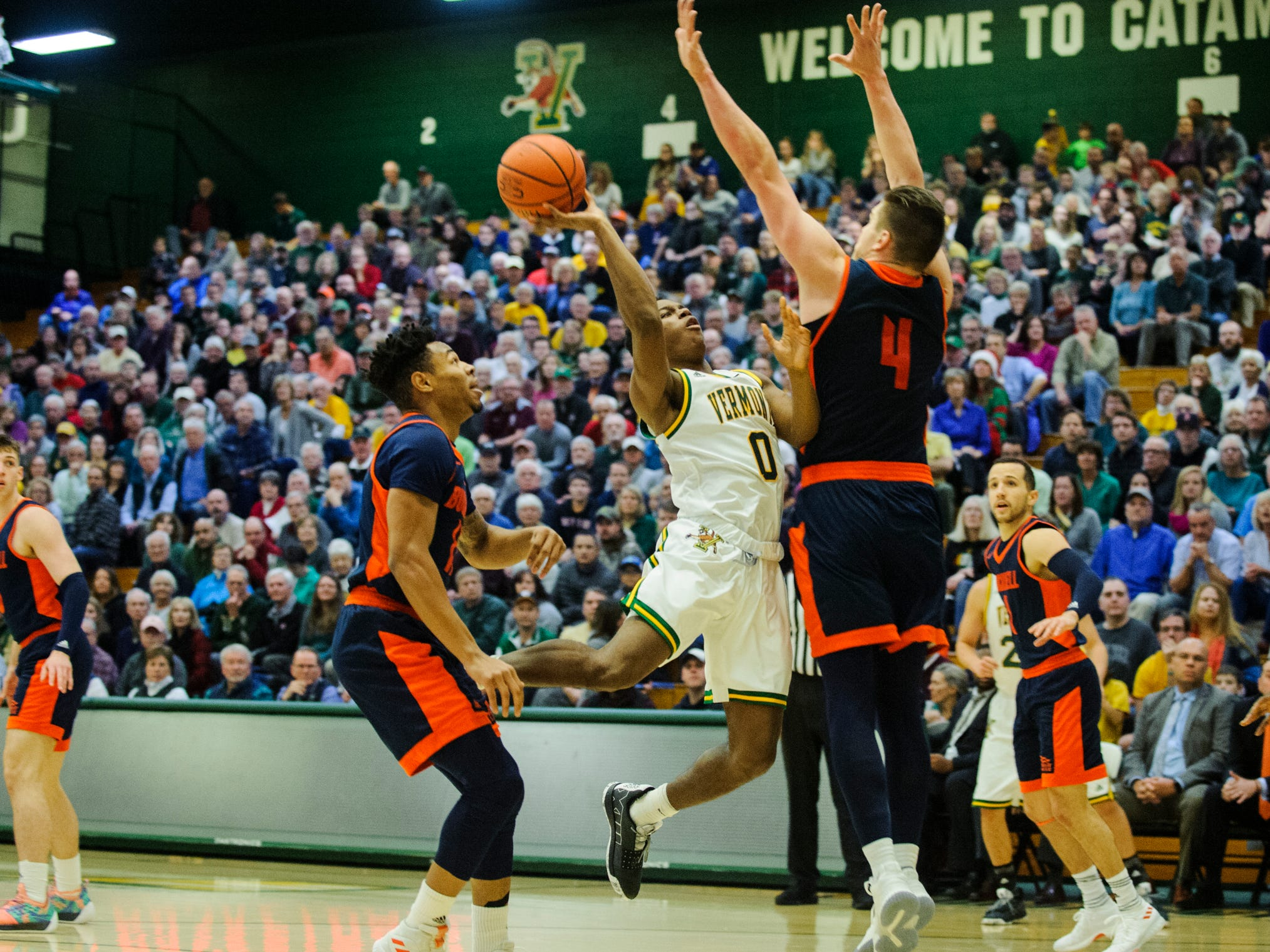Vermont guard Stef Smith (0) takes a shot during the men's basketball game between the Bucknell Bison and the Vermont Catamounts at Patrick Gym on Sunday afternoon November 25, 2018 in Burlington.