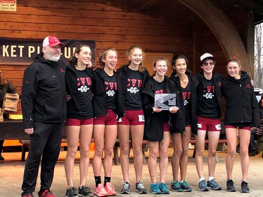 The Champlain Valley girls cross-country running team holds its runner-up trophy at the Northeast Regional championships at Wappinger Falls, New York on Saturday, Nov. 24, 2018.