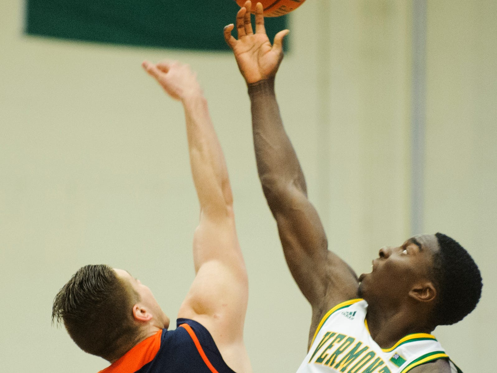 Vermont forward Ra Kpedi (15) and Bucknell's Nate Sestina (4) battle for the opening tip off during the men's basketball game between the Bucknell Bison and the Vermont Catamounts at Patrick Gym on Sunday afternoon November 25, 2018 in Burlington.