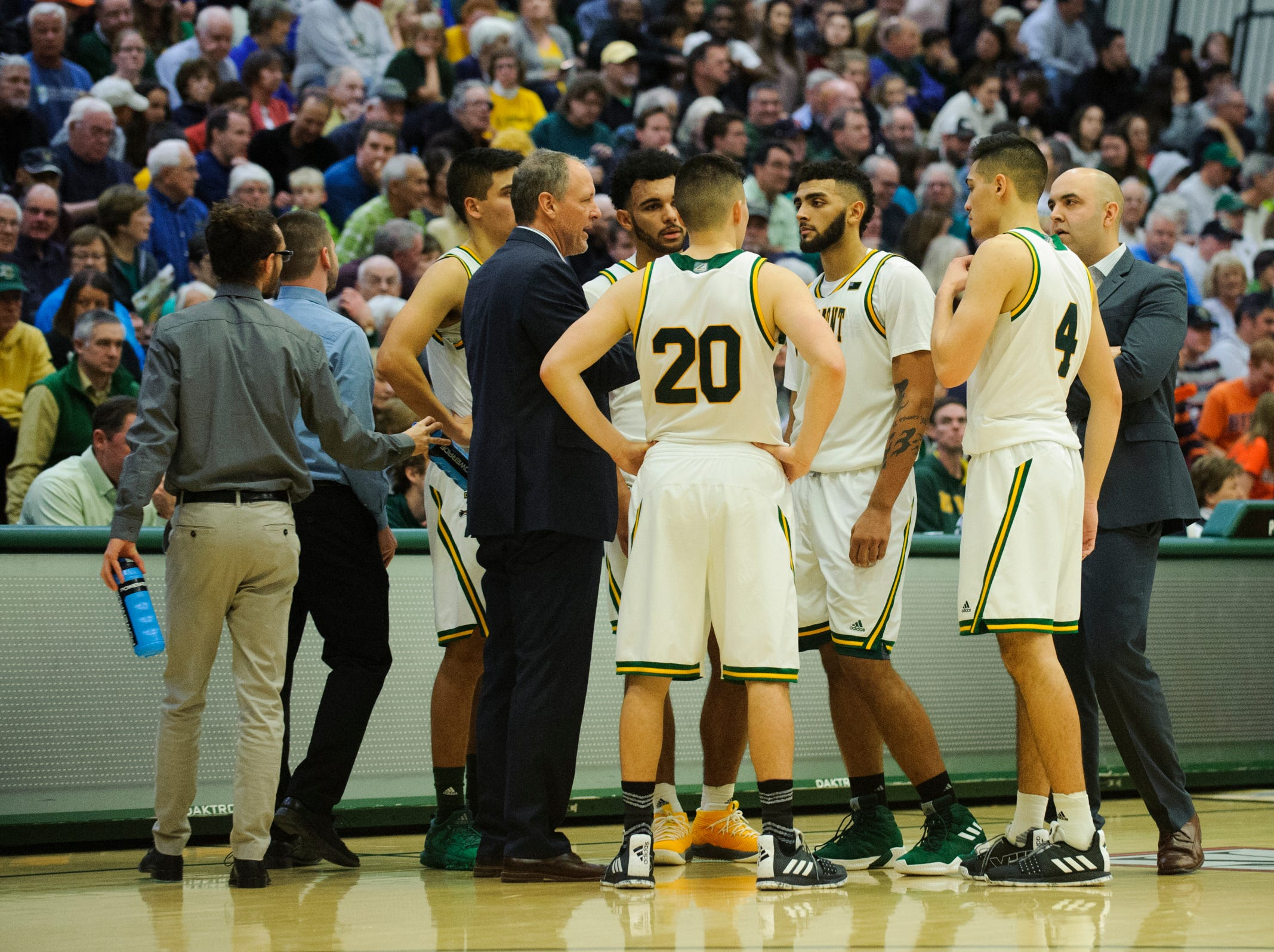 Vermont huddles together during a break in the action during the men's basketball game between the Bucknell Bison and the Vermont Catamounts at Patrick Gym on Sunday afternoon November 25, 2018 in Burlington.
