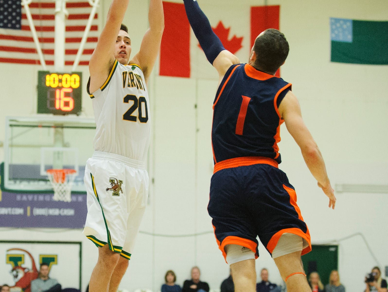 Vermont guard Ernie Duncan (20) shoots a three pointer over Bucknell's Kimbal Mackenzie (1) during the men's basketball game between the Bucknell Bison and the Vermont Catamounts at Patrick Gym on Sunday afternoon November 25, 2018 in Burlington.