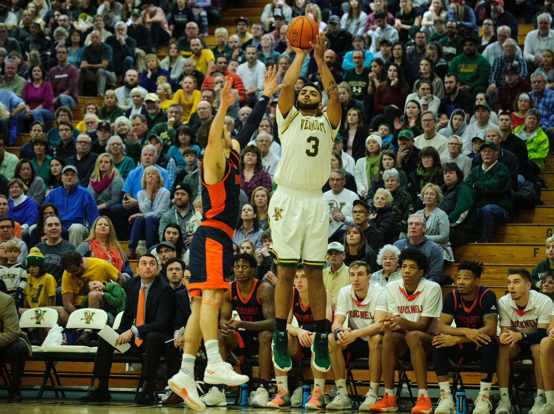 Vermont forward Anthony Lamb (3) shoots a three pointer during the men's basketball game between the Bucknell Bison and the Vermont Catamounts at Patrick Gym on Sunday afternoon November 25, 2018 in Burlington.